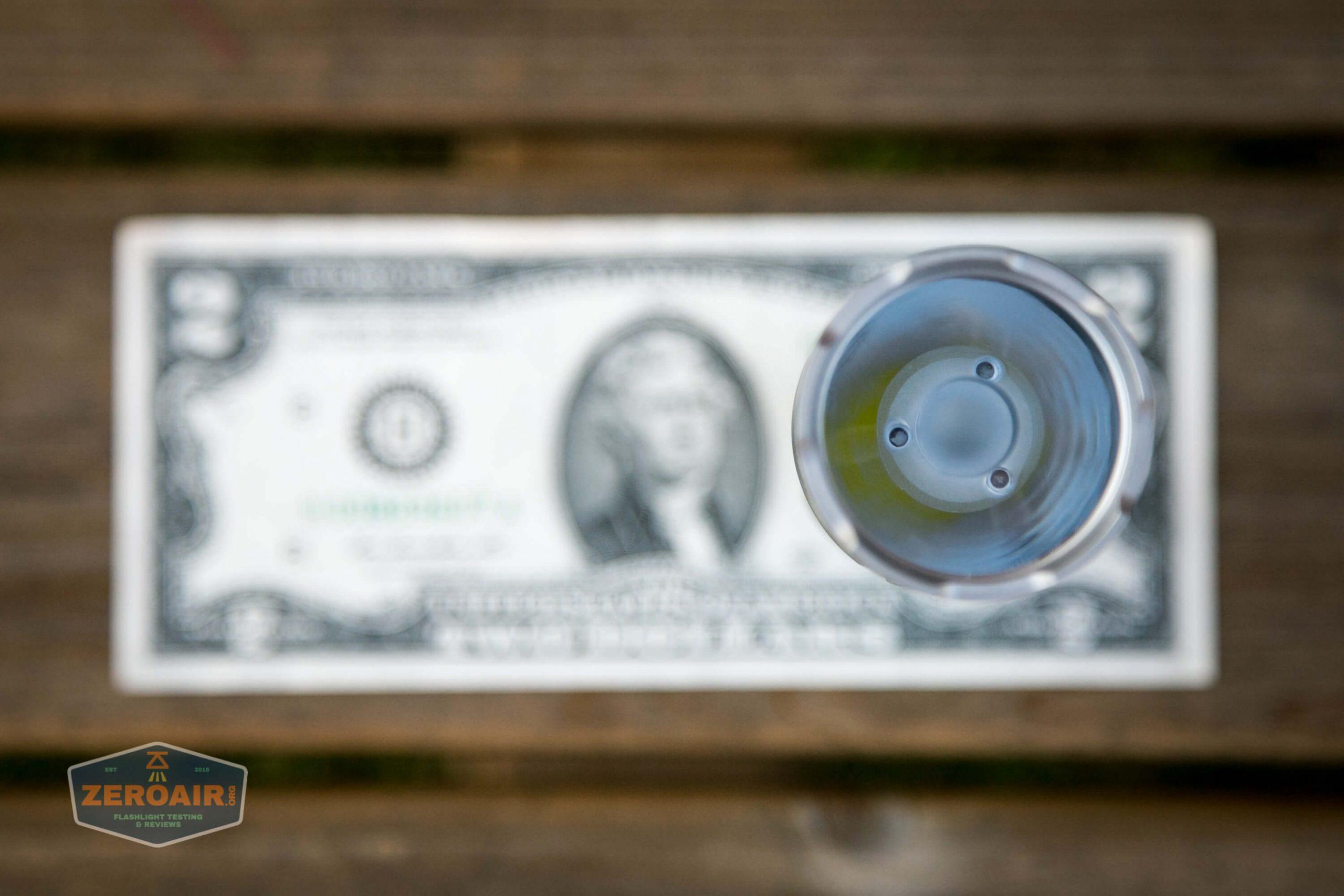 acebeam l17 osram white 18650 thrower on two dollar bill