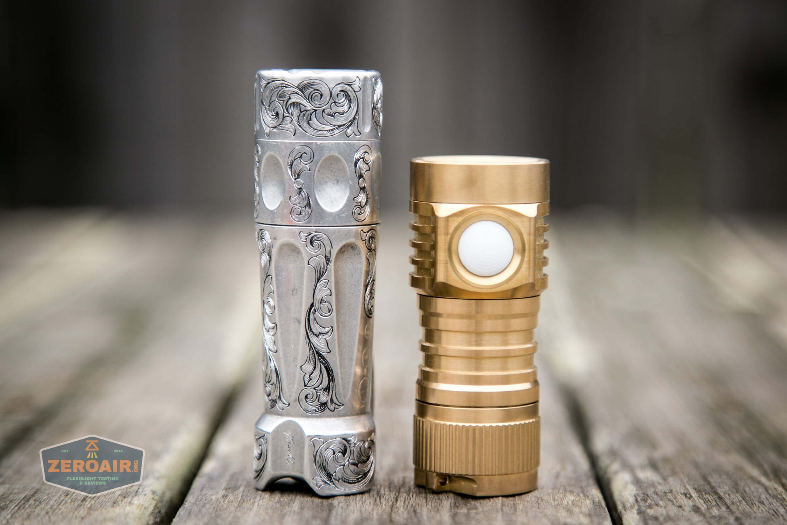 emisar d4v2 brass flashlight nichia e21a 4500K beside torchlab boss 35