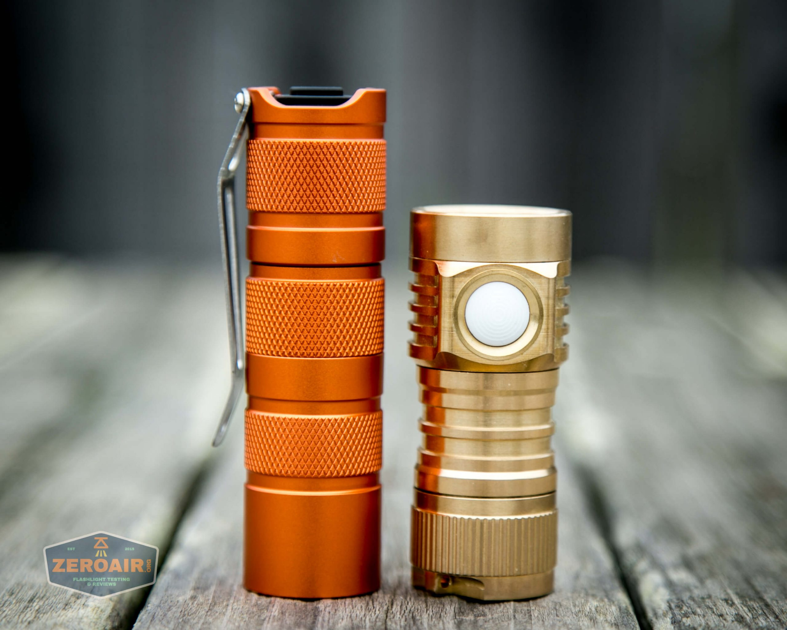 emisar d4v2 brass flashlight nichia e21a 4500K beside convoy s2+