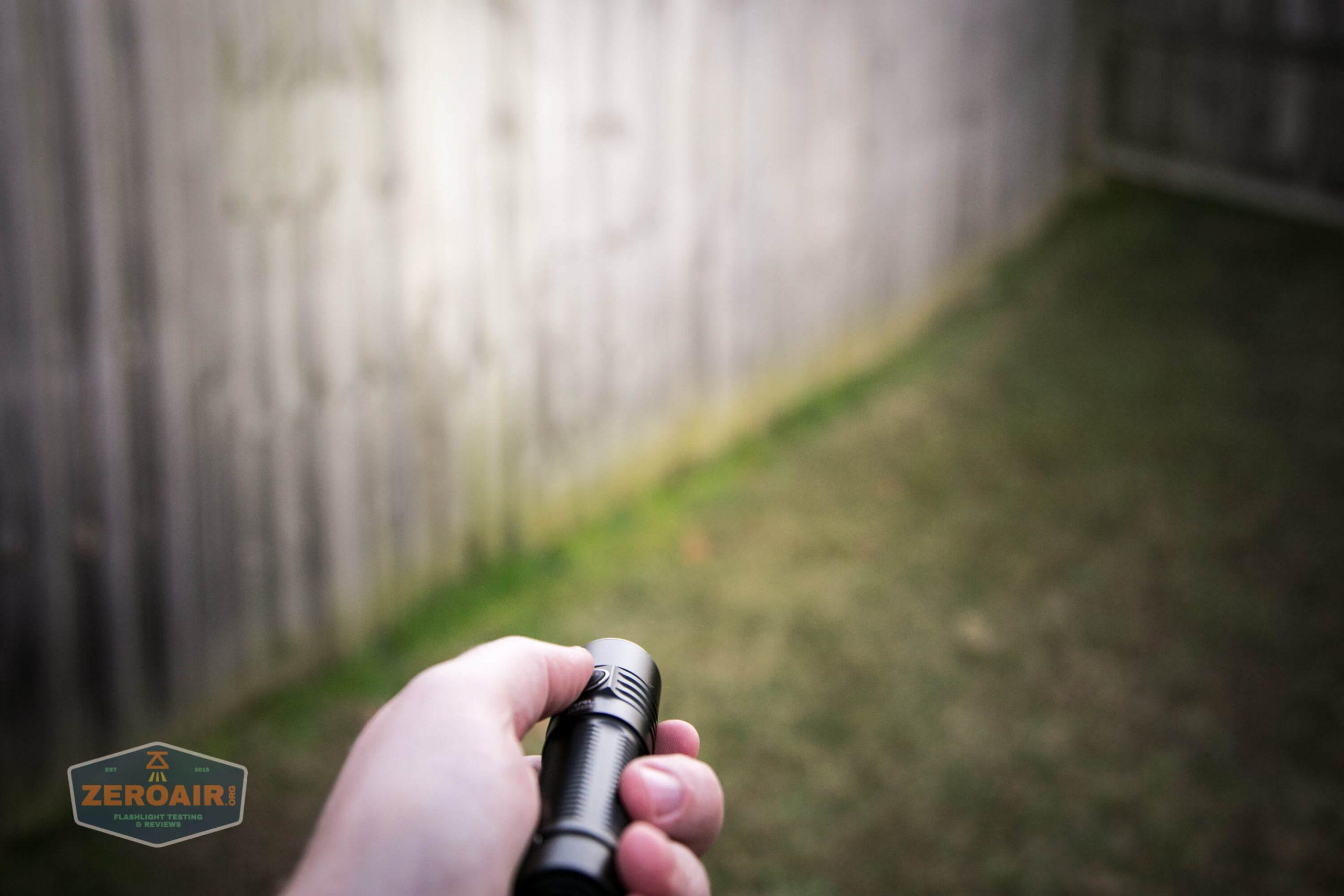 klarus g25 21700 cree xhp70.2 flashlight in hand beamshot