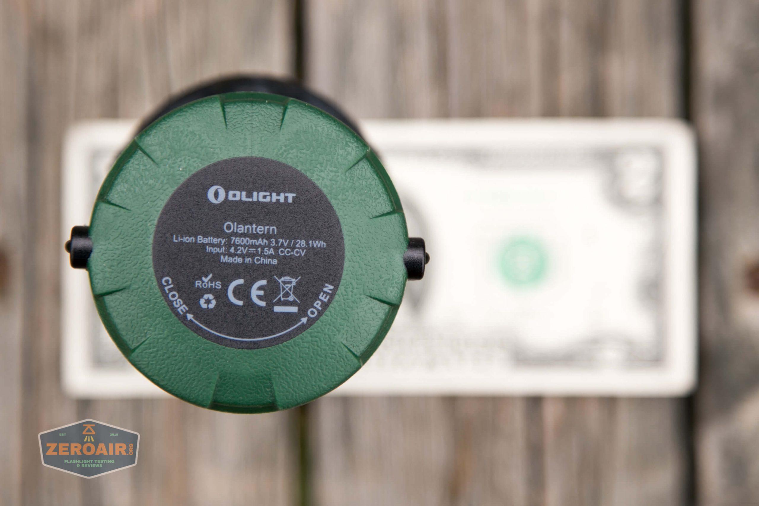 olight olantern lantern on two dollar bill