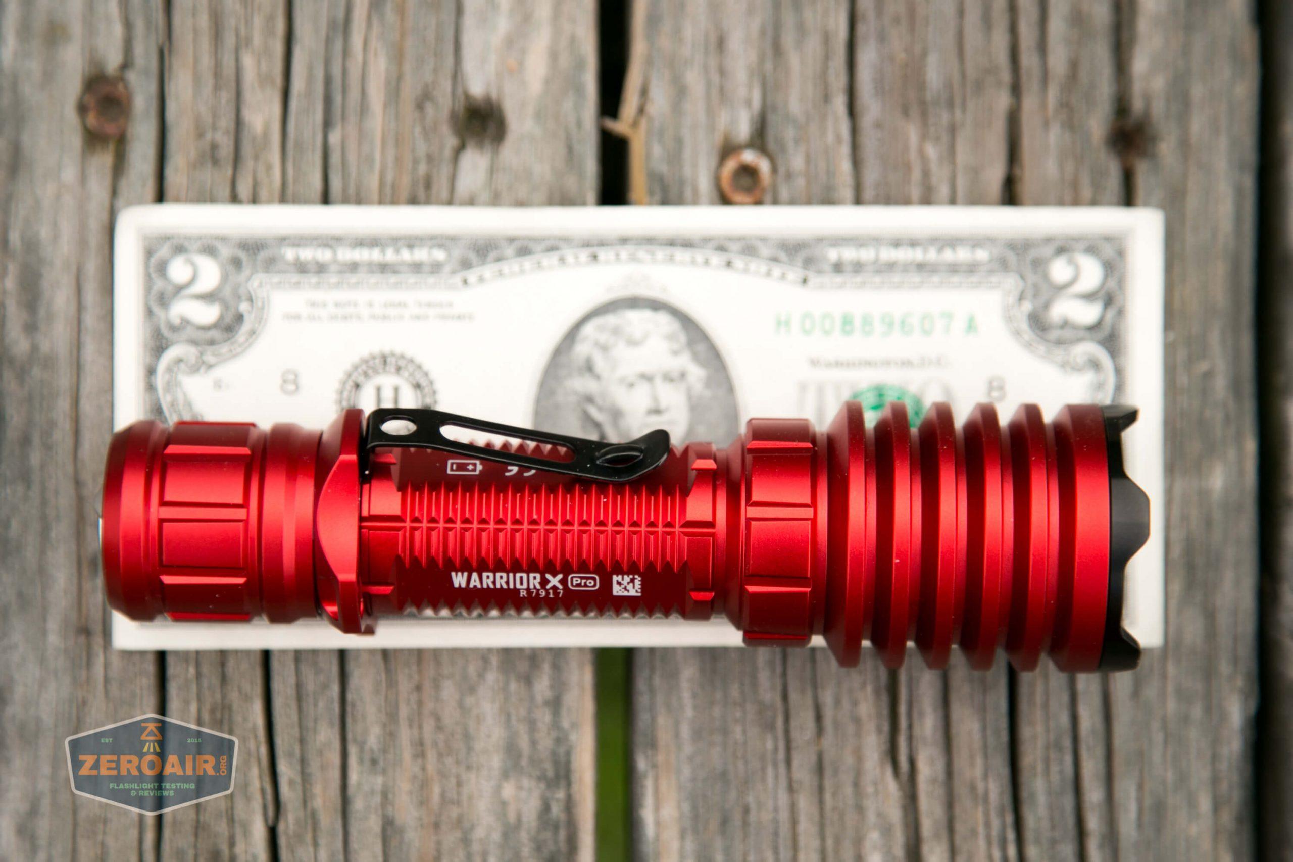 olight warrior x pro 21700 cree xhp35 hi on two dollar bill