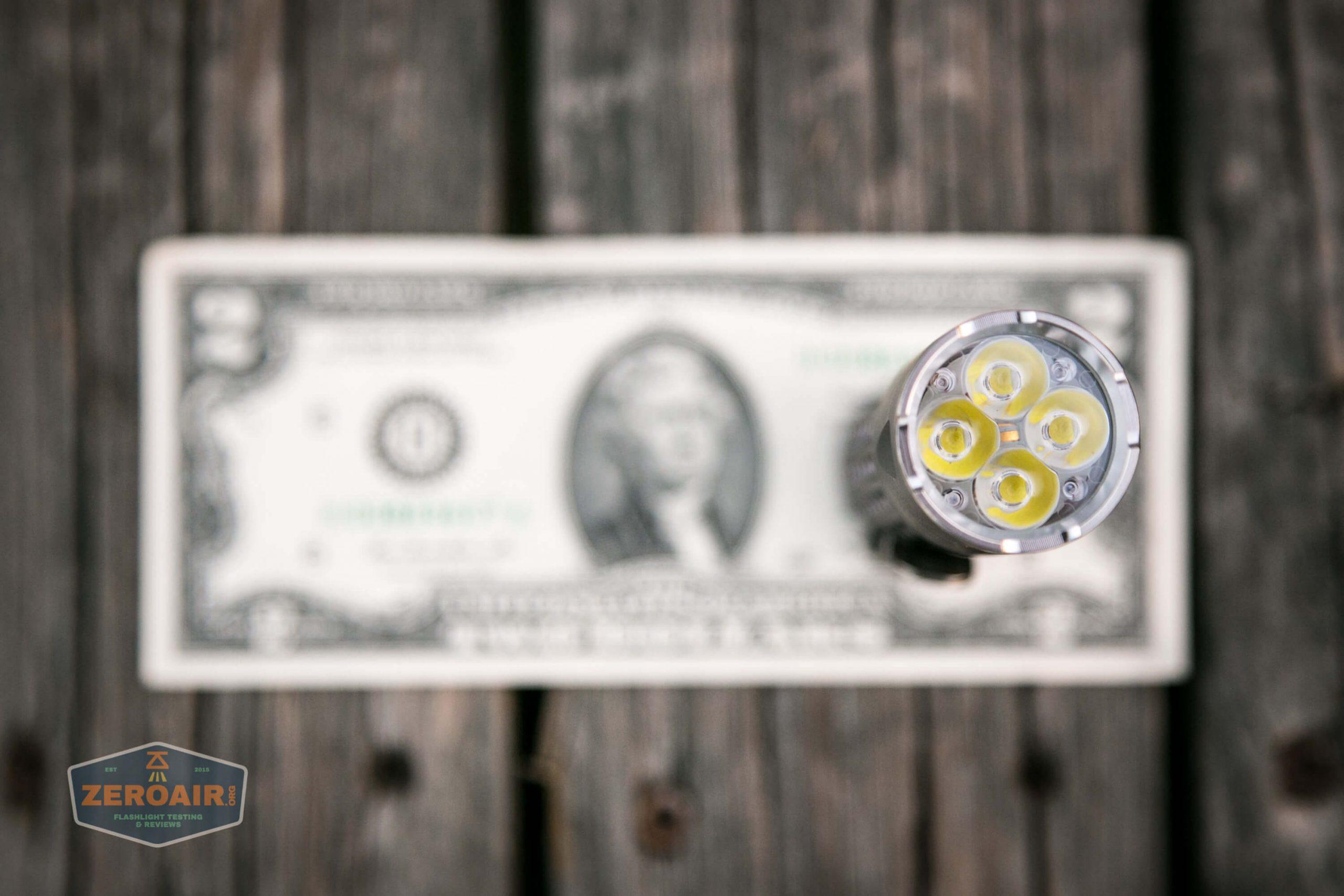 countycomm reylight 21700 quad emitter flashlight on two dollar bill