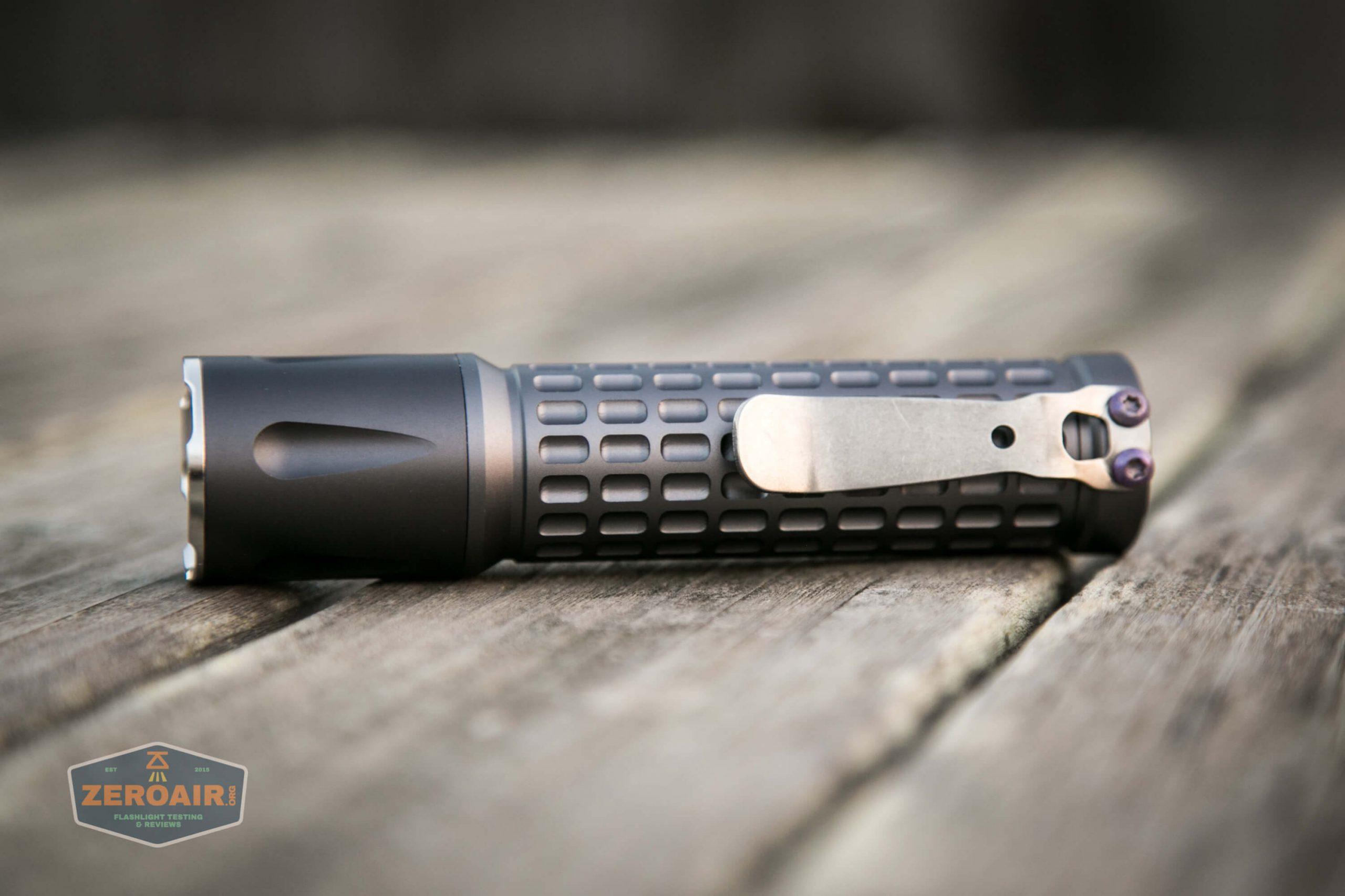 countycomm reylight 21700 quad emitter flashlight laying on side