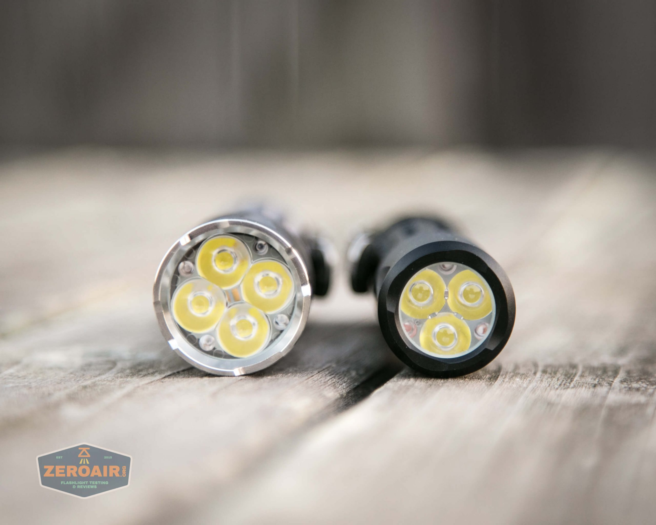 countycomm reylight 21700 quad emitter flashlight beside reylight triple
