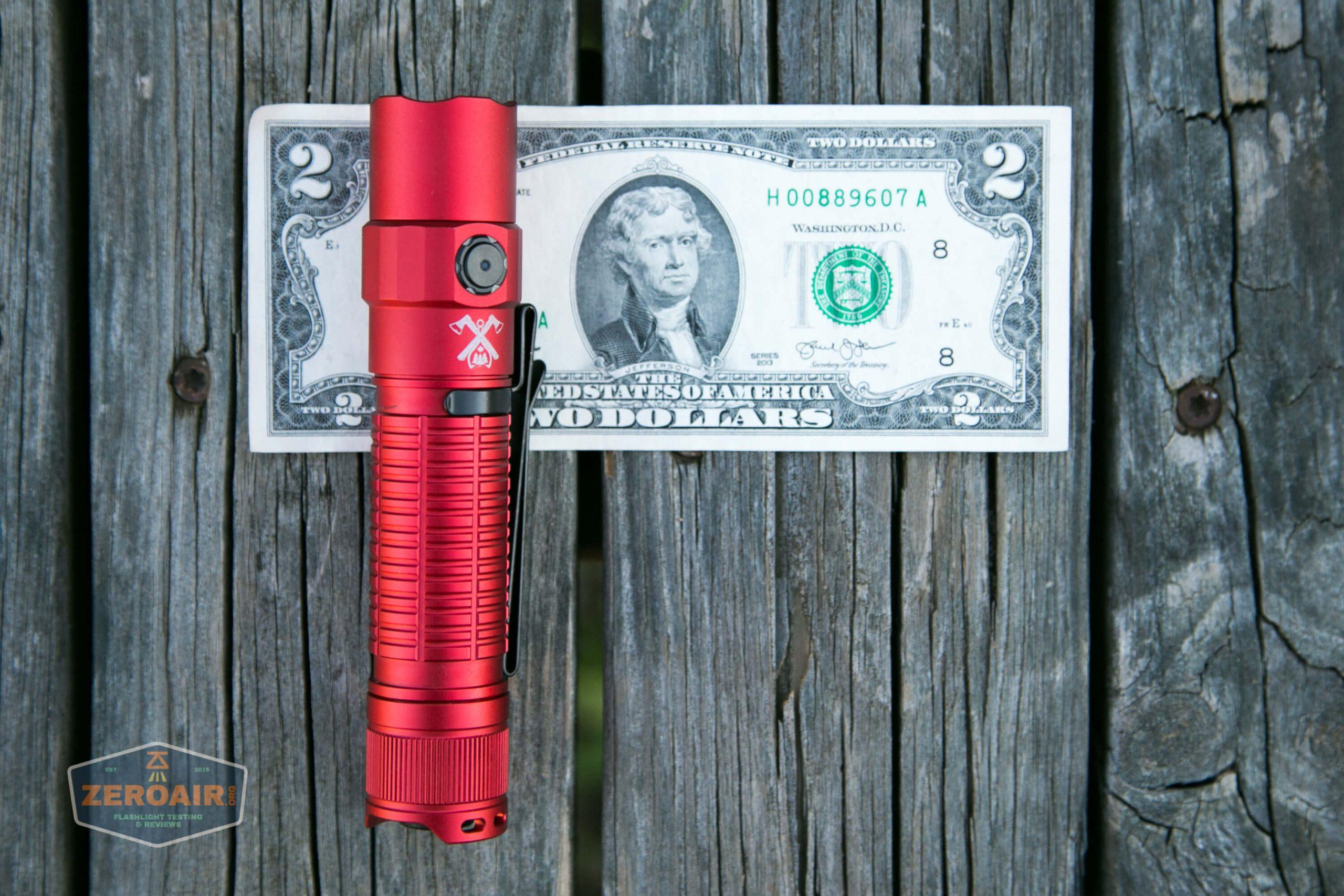 thrunite tt20 the outsider red 21700 flashlight on two dollar bill