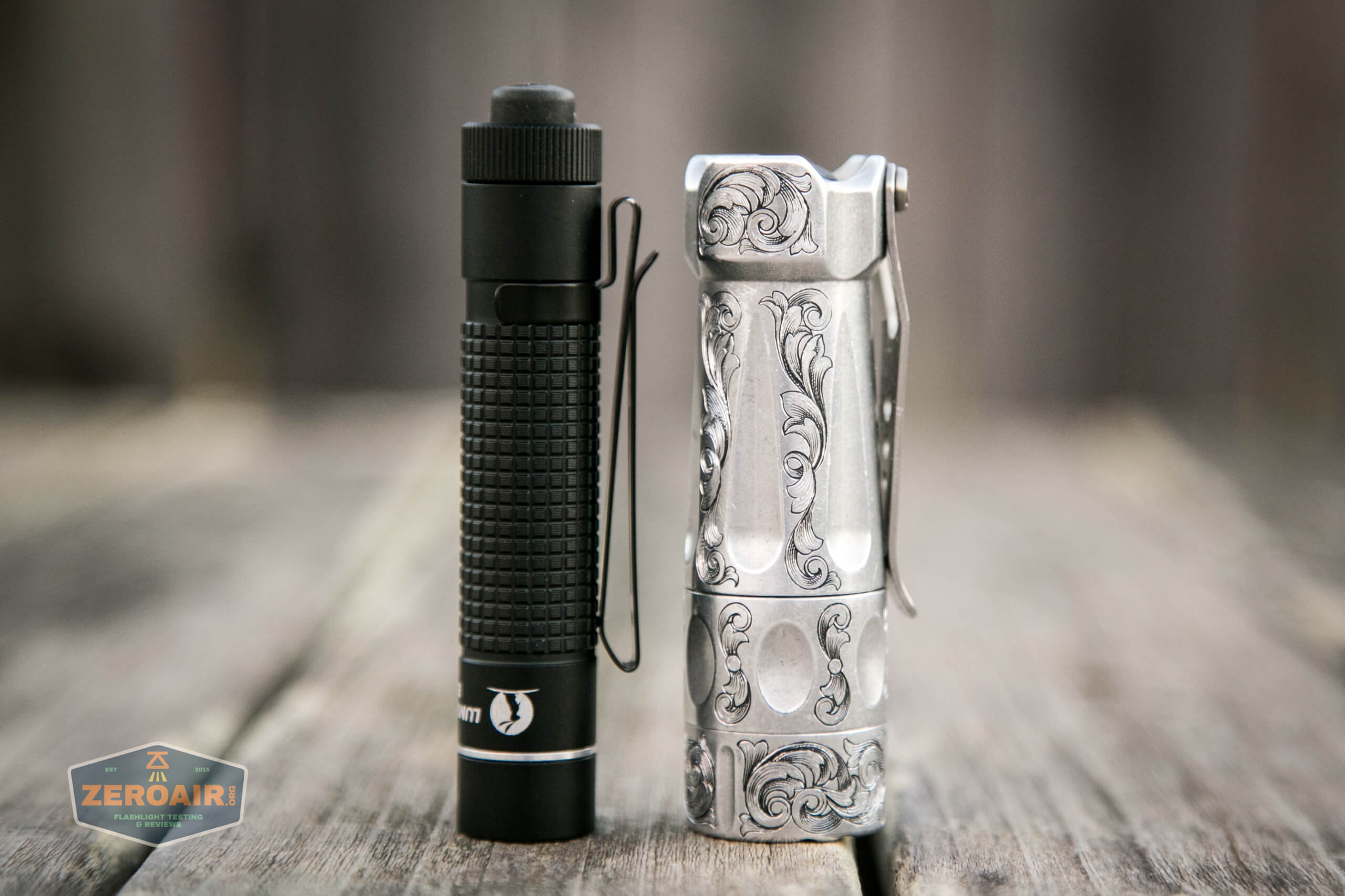 lumintop edc aa flashlight beside torchlab boss 35