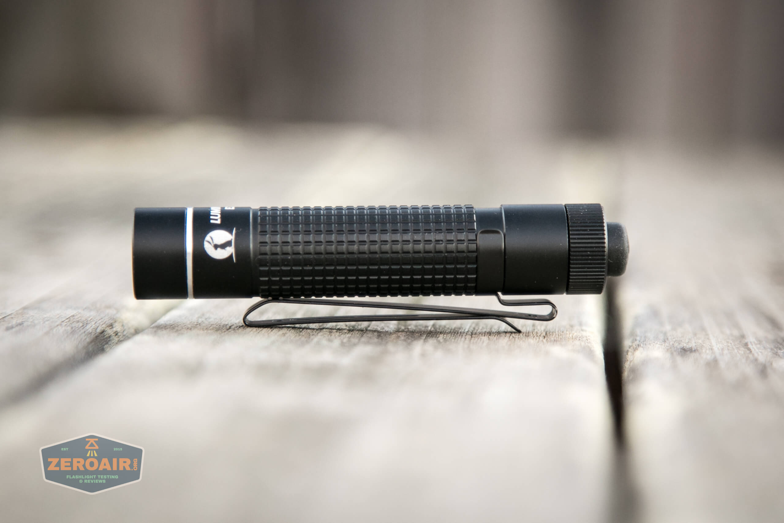 lumintop edc aa flashlight resting on two way clip