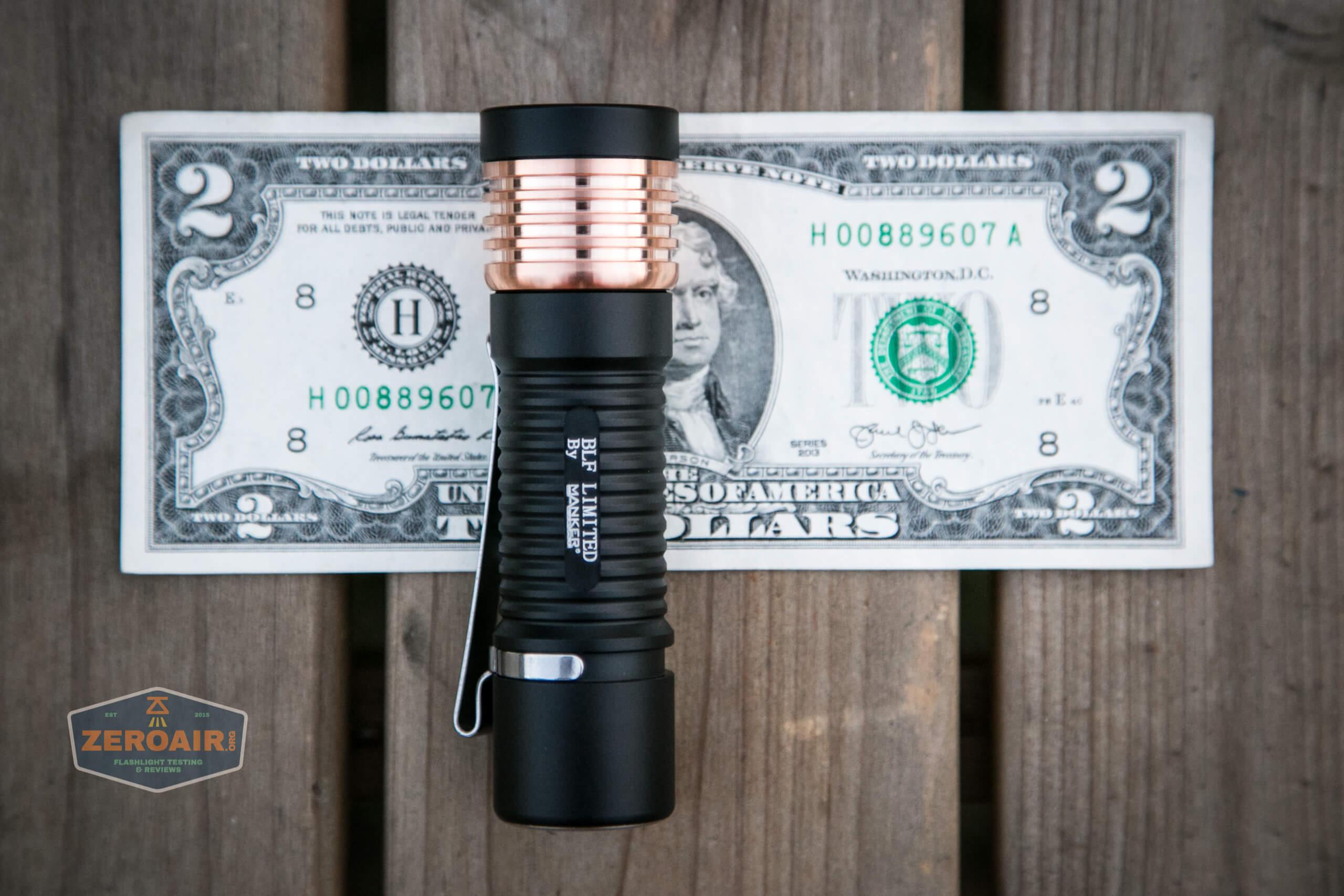 manker e14iii 18650 flood flashlight on two dollar bill