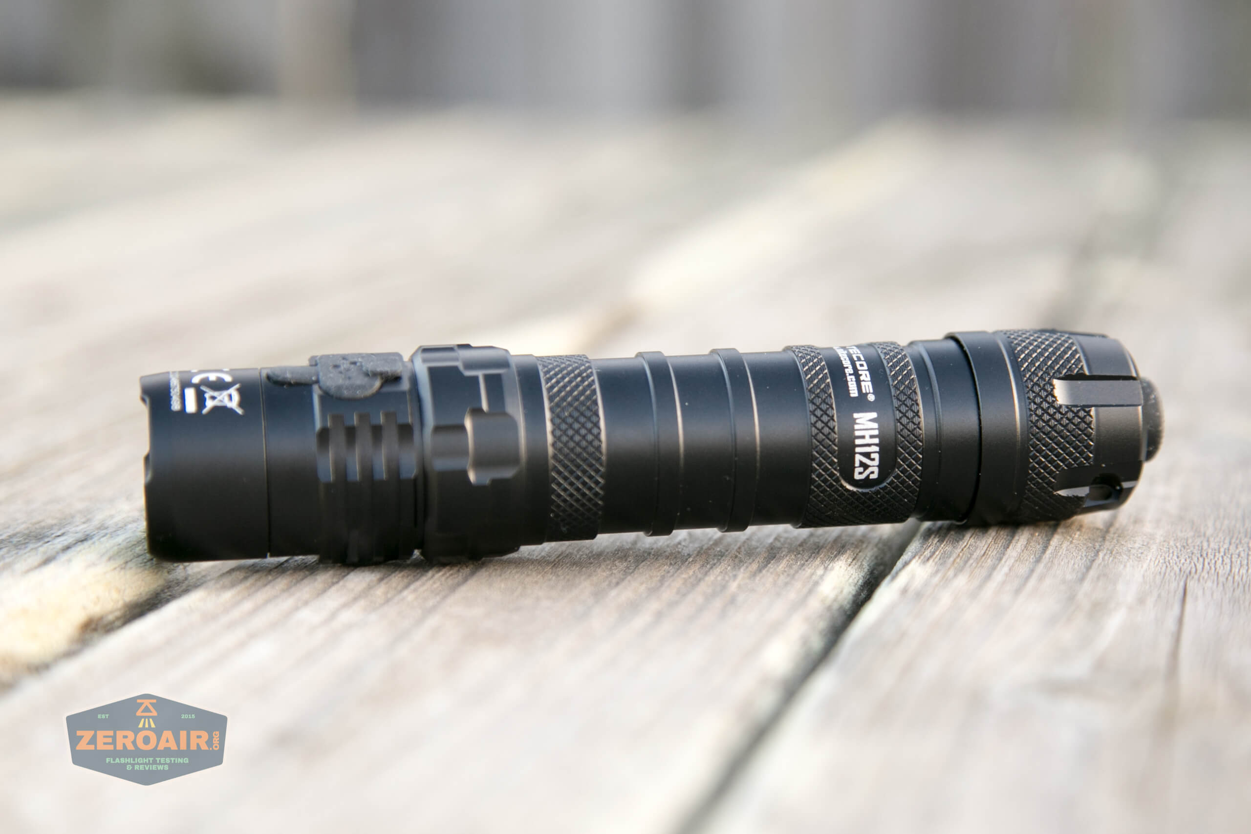 nitecore mh12s tactical flashlights laying on side