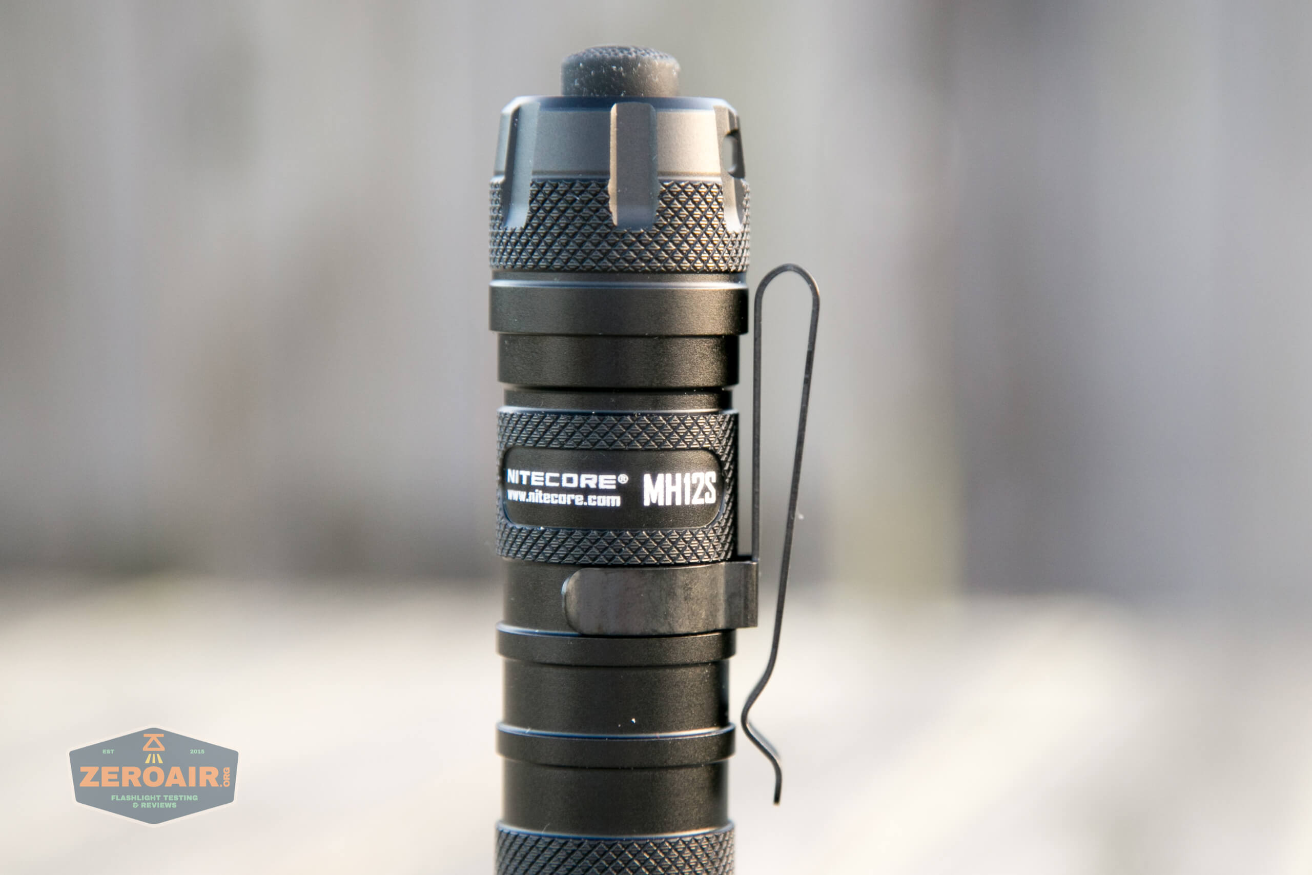 nitecore mh12s tactical flashlights pocket clip on end