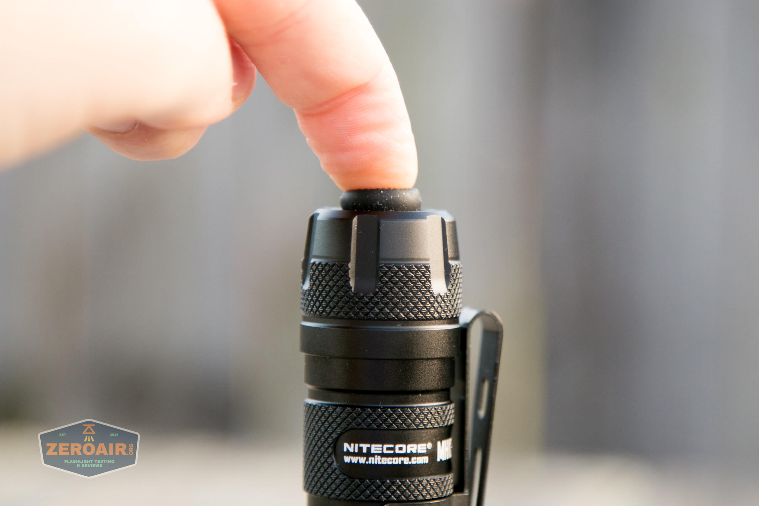 nitecore mh12s tactical flashlight tail switch depressed