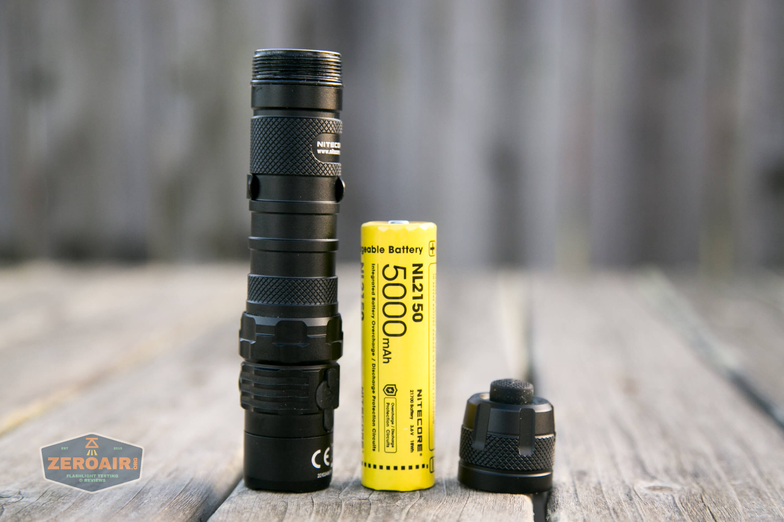 nitecore mh12s tactical flashlight tail off showing 21700 cell