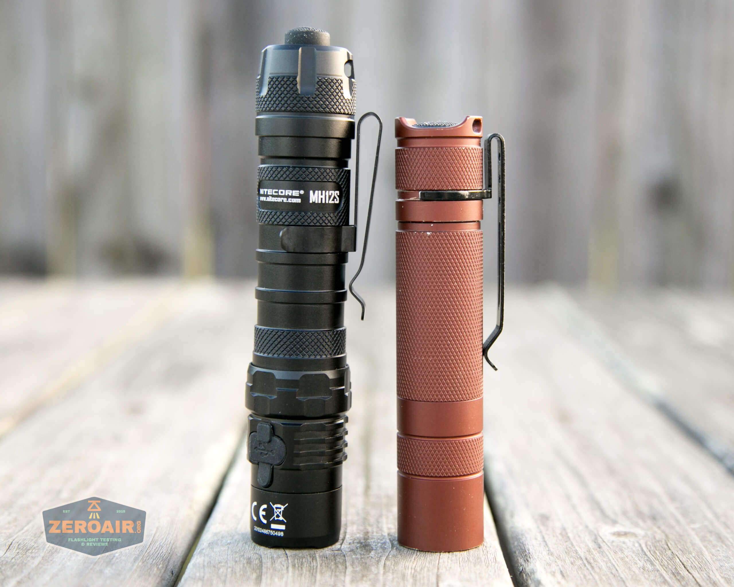 nitecore mh12s tactical flashlight beside convoy s2+