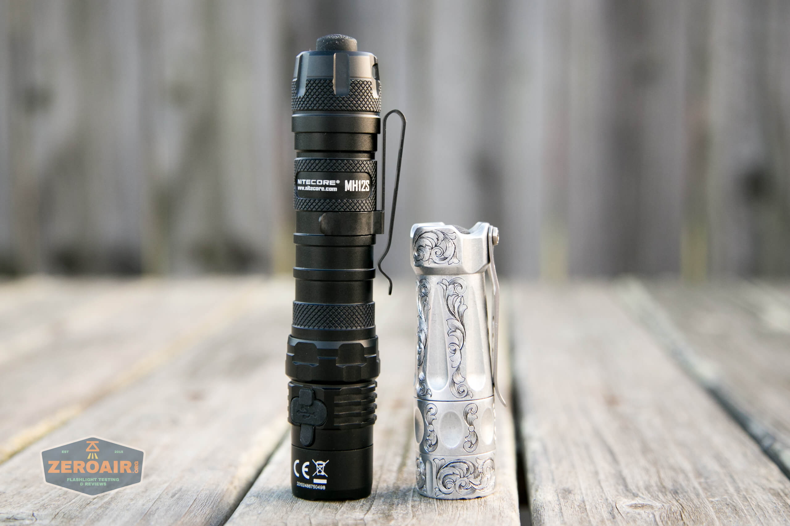 nitecore mh12s tactical flashlight beside torchlab boss 35