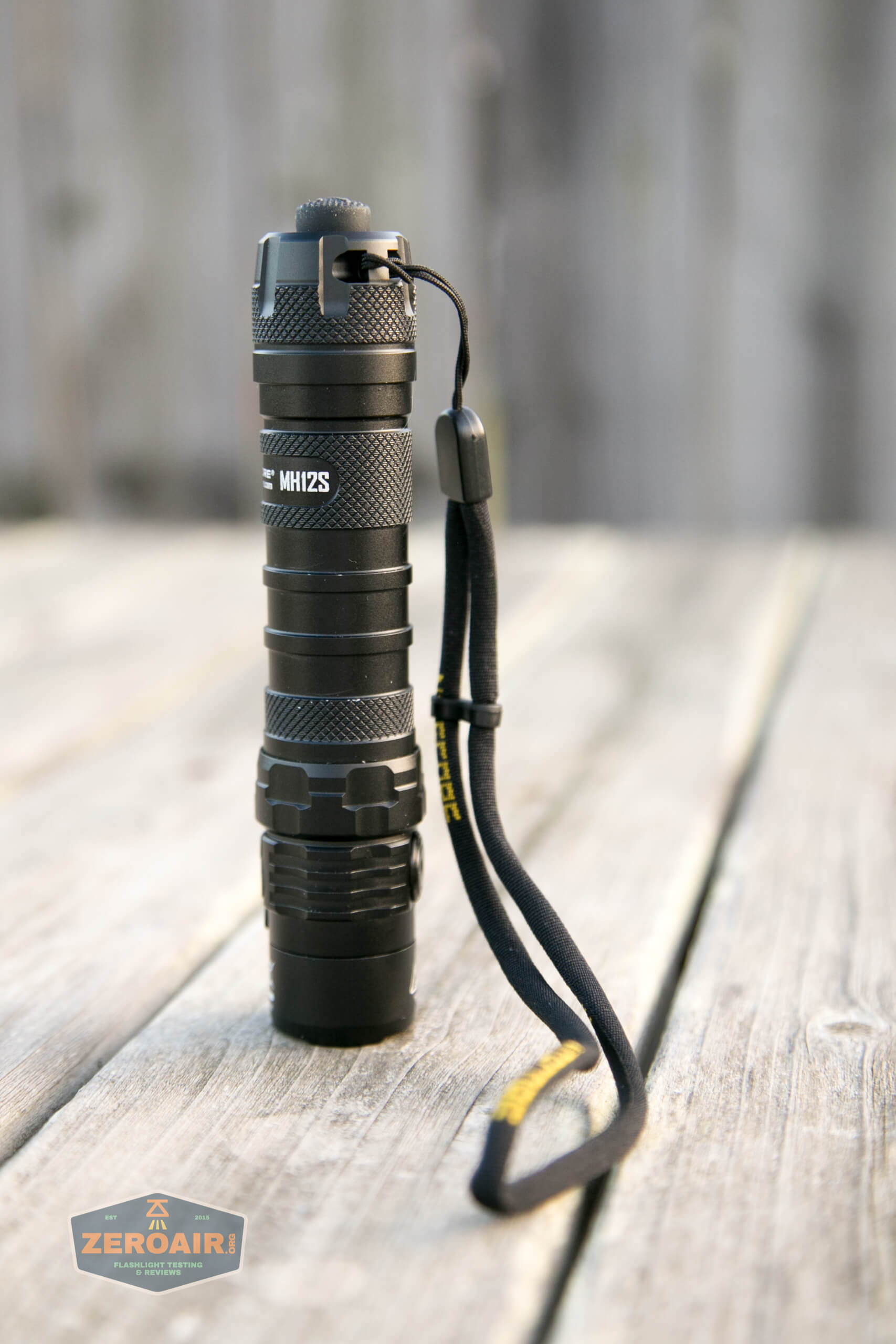 nitecore mh12s tactical flashlight lanyard installed