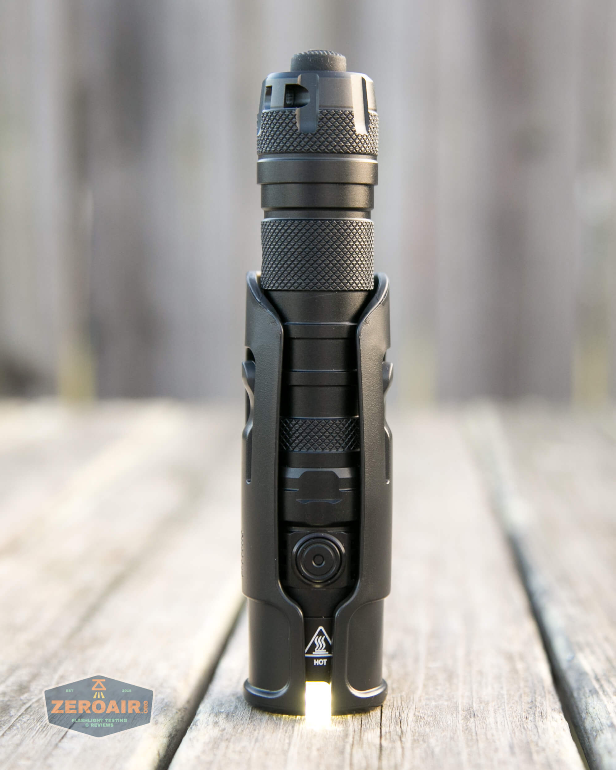 nitecore mh12s tactical flashlight in holster with light on