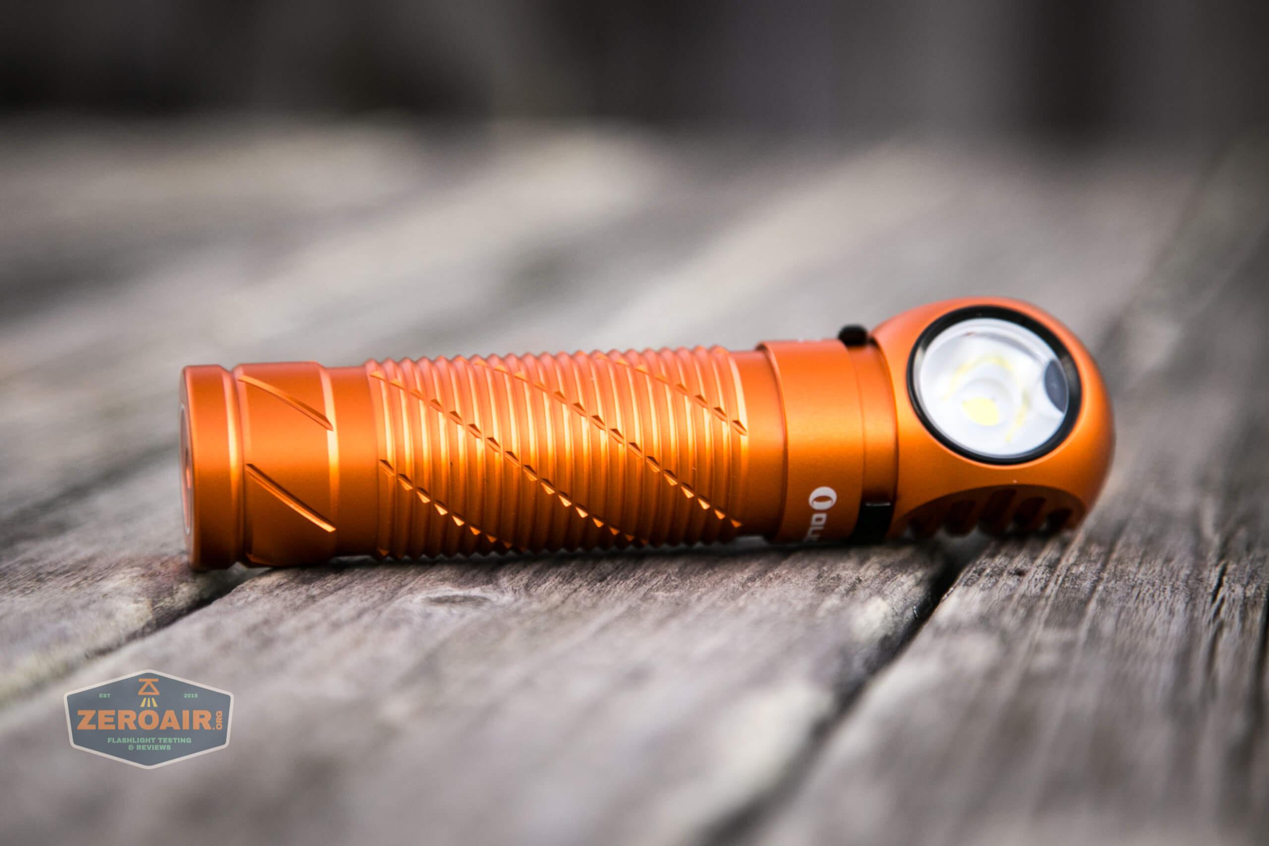 olight perun 2 21700 headlamp orange laying on side