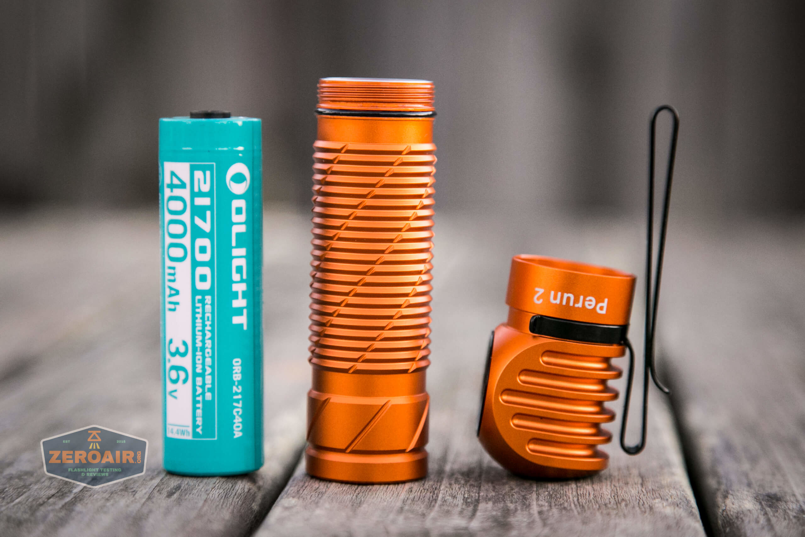 olight perun 2 21700 headlamp orange head off and cell out