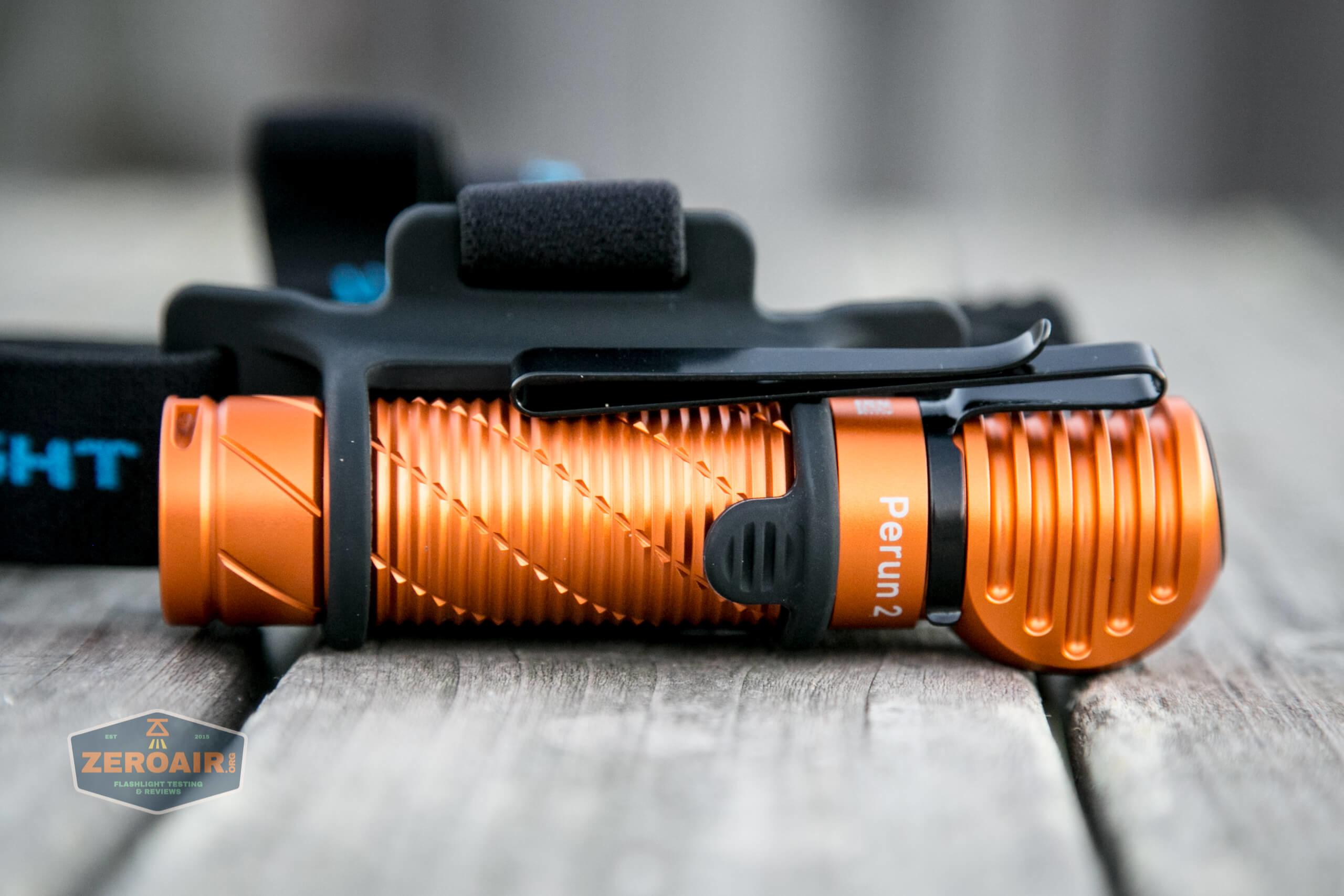 olight perun 2 21700 headlamp orange installed in headband