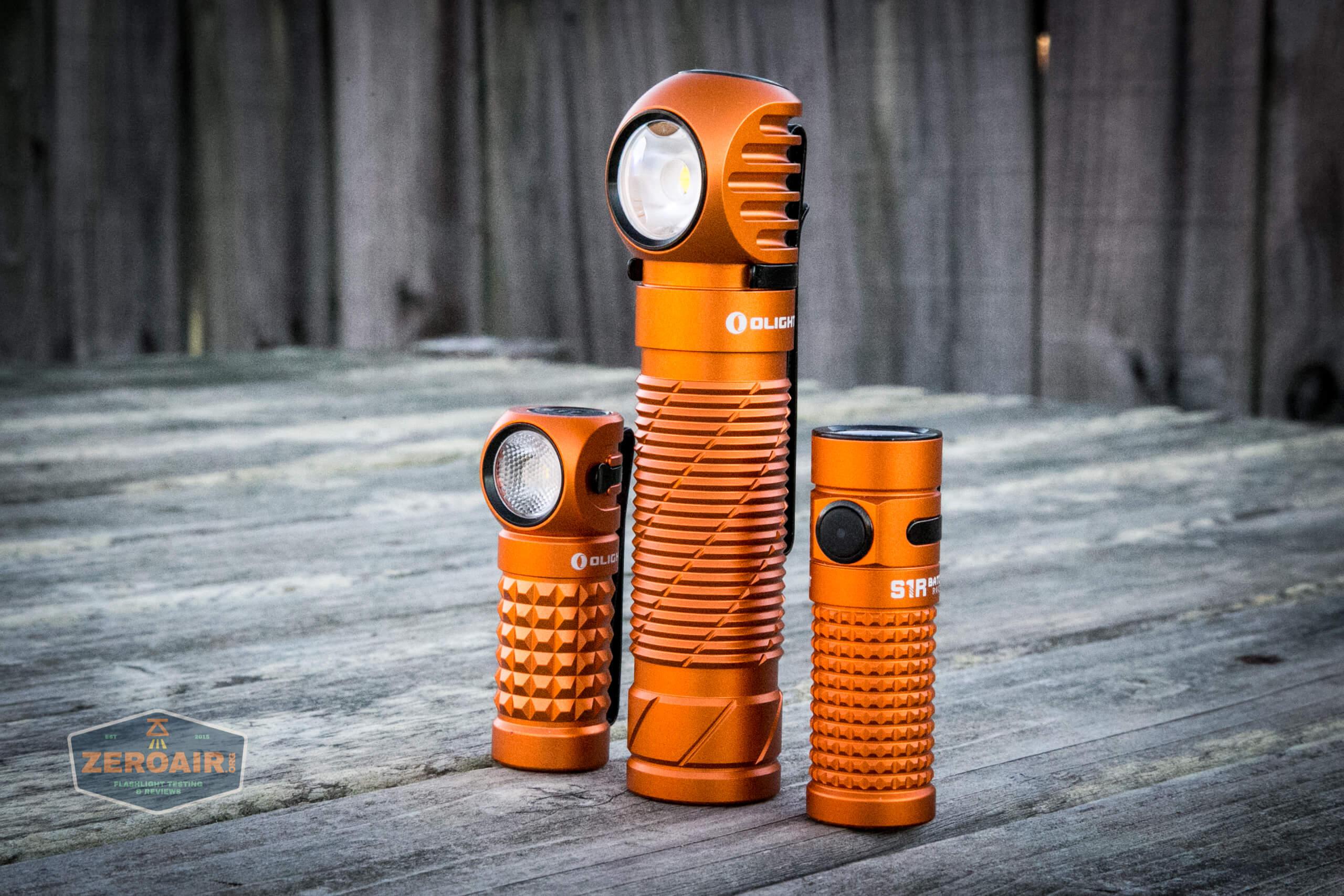 olight perun 2 21700 headlamp orange beside other orange olights
