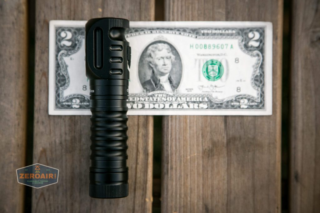 wurkkos hd20 21700 headlamp on two dollar bill