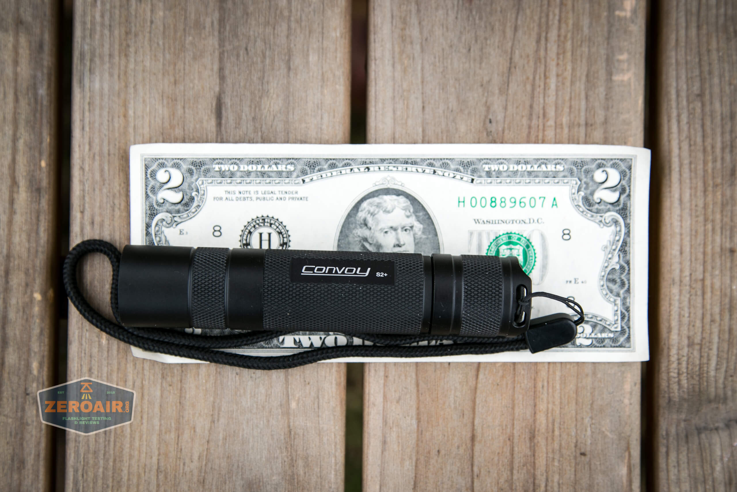 convoy s2+ uv flashlight on two dollar bill