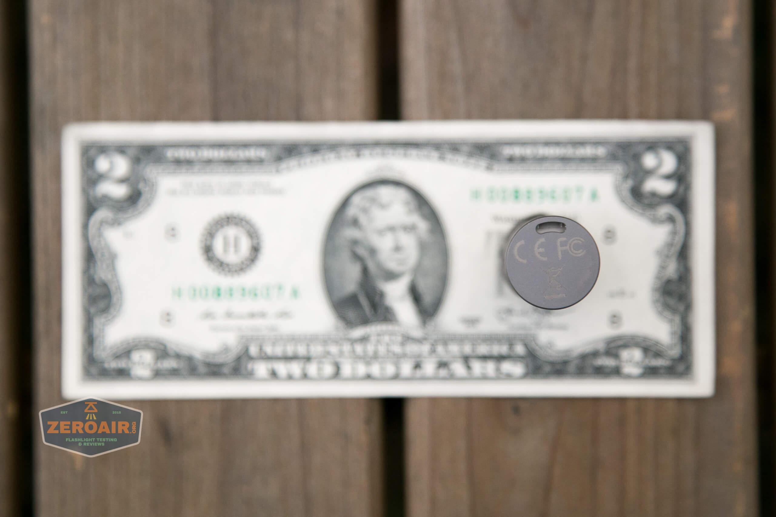 freasygears cyansky m3 titanium pocket flashlight on two dollar bill