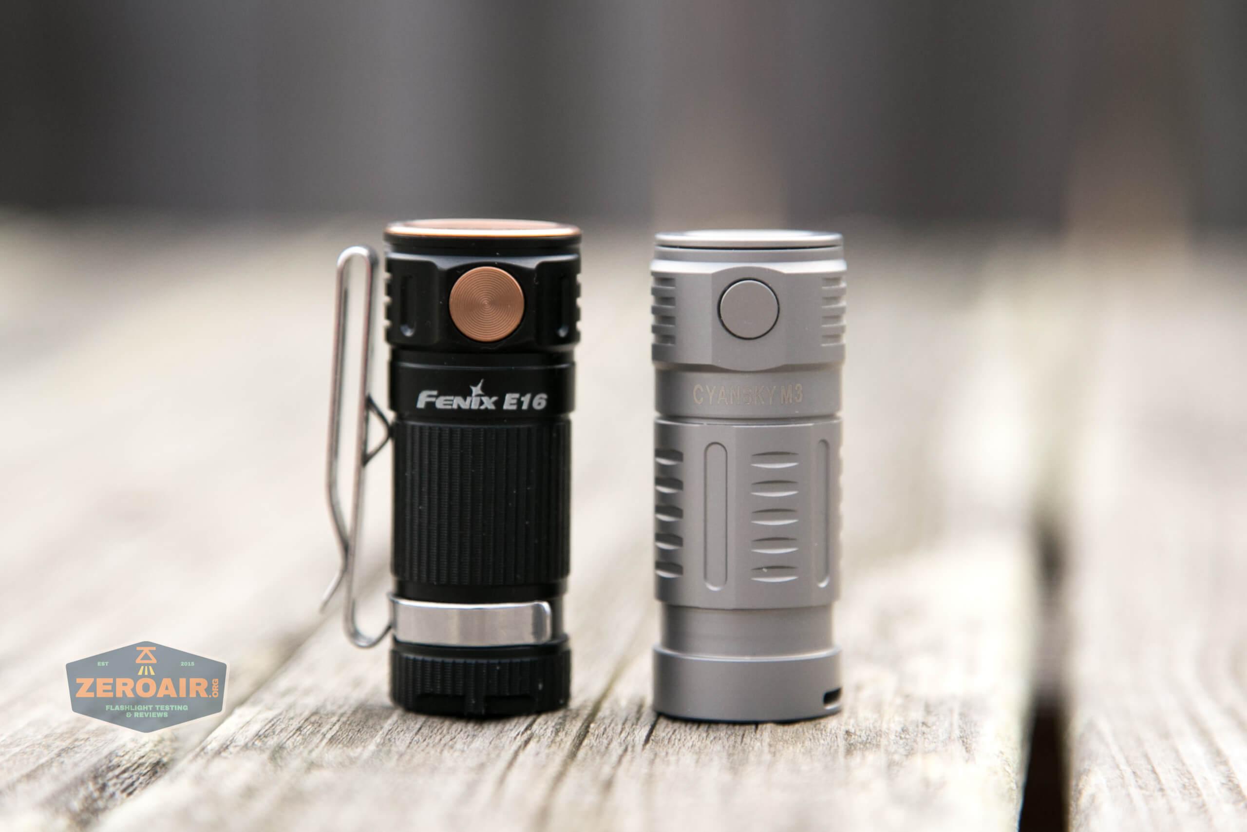freasygears cyansky m3 titanium pocket flashlight beside fenix e16