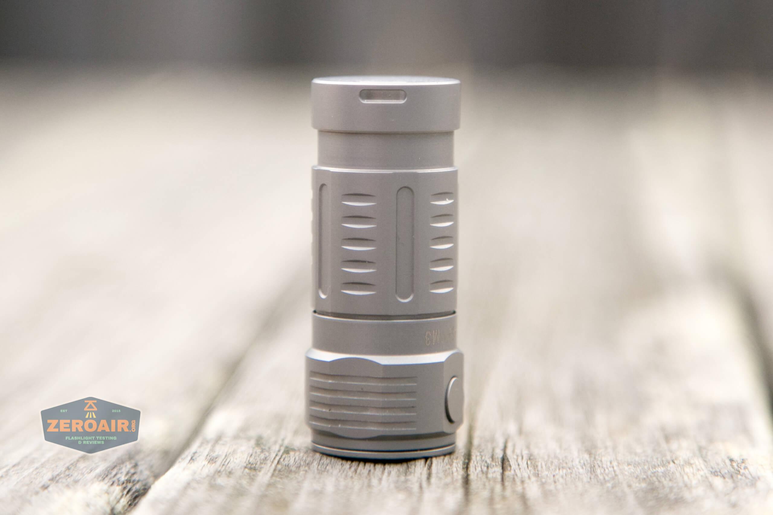 freasygears cyansky m3 titanium pocket flashlight headstanding