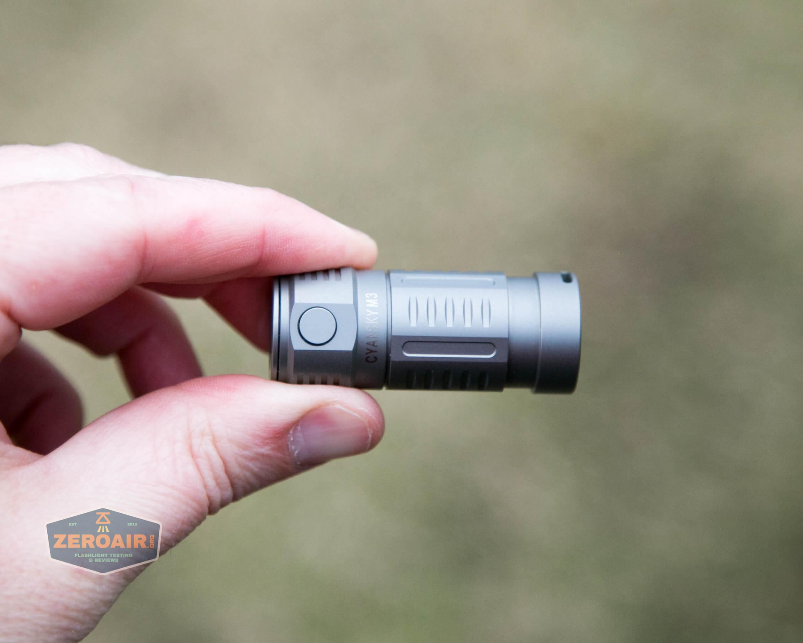freasygears cyansky m3 titanium pocket flashlight in hand