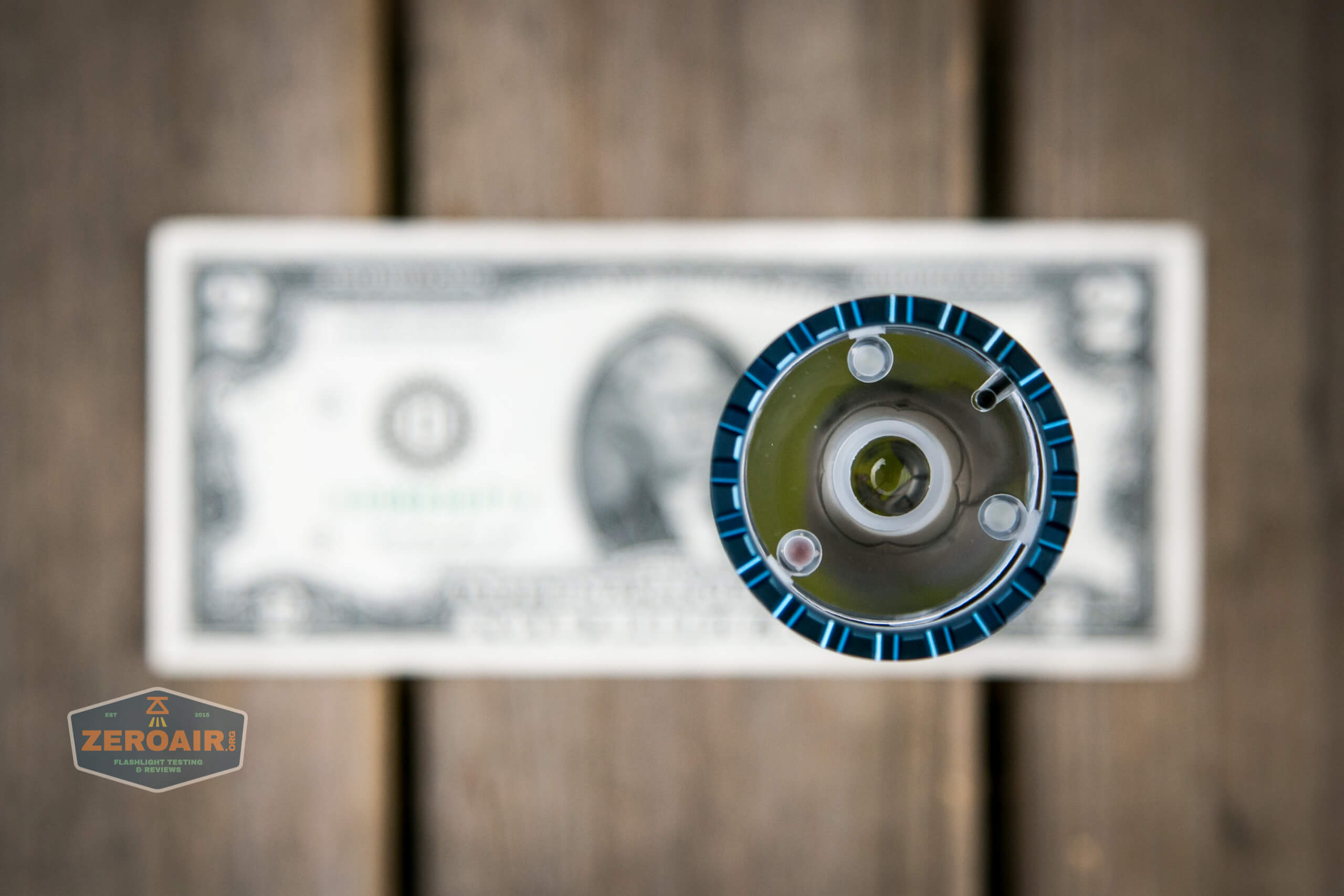 olight freyr rgb flashlight on two dollar bill