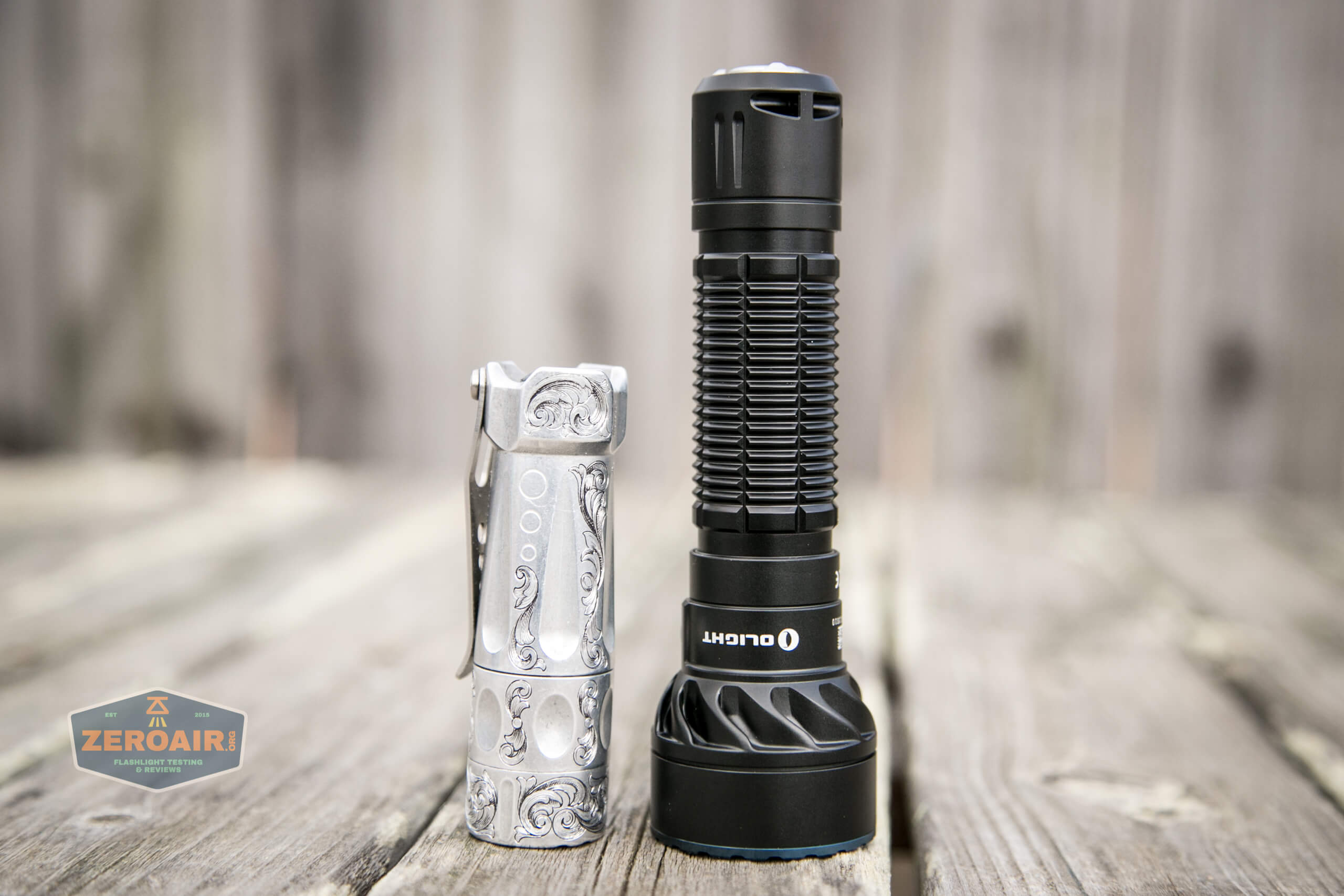 olight freyr rgb flashlight beside torchlab boss 35