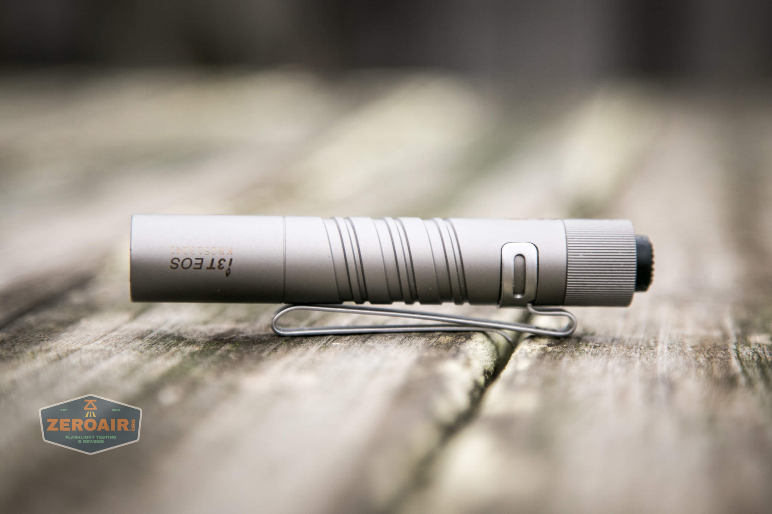 olight i3t eos titanium aaa flashlight upside down logo