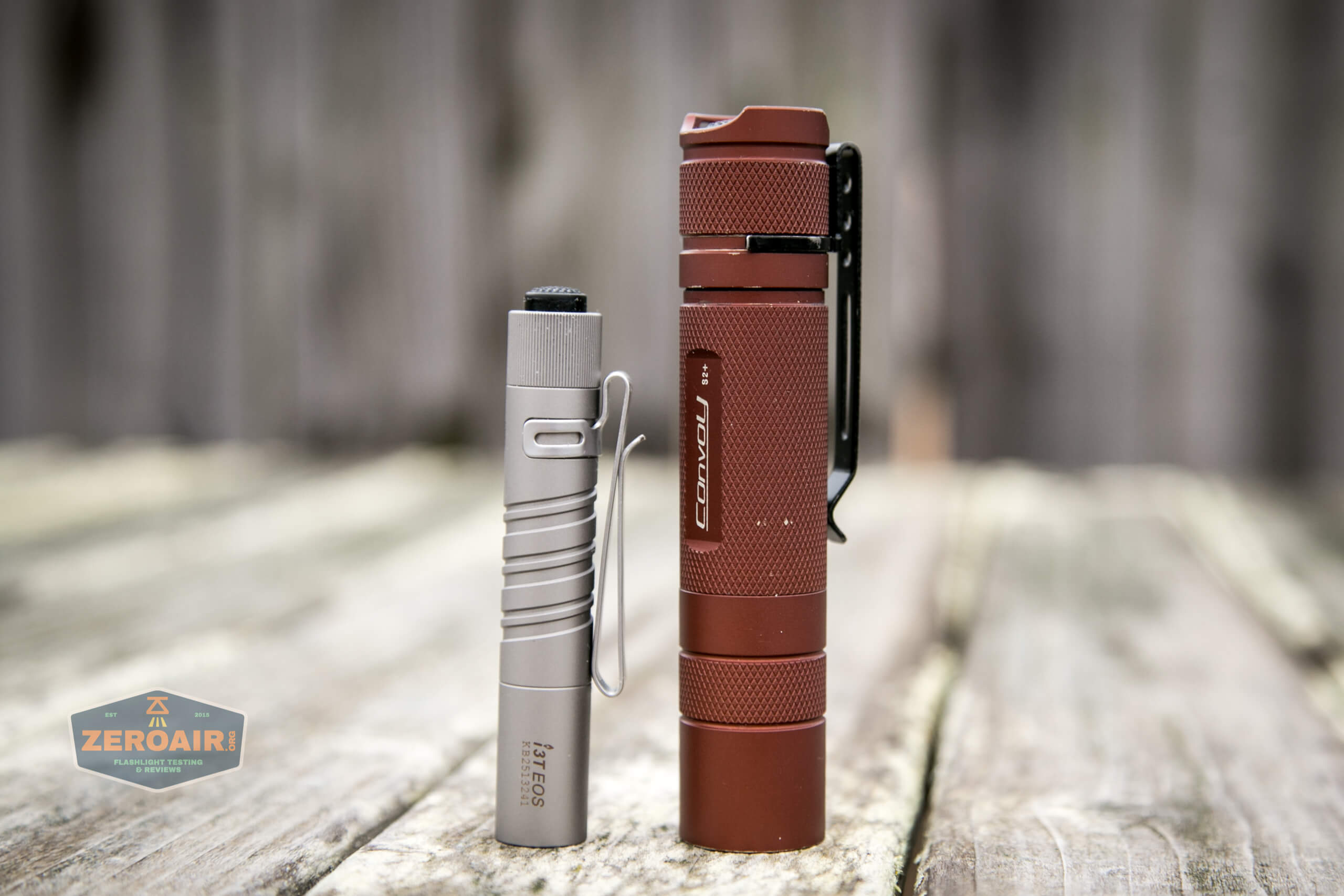 olight i3t eos titanium aaa flashlight beside convoy s2+