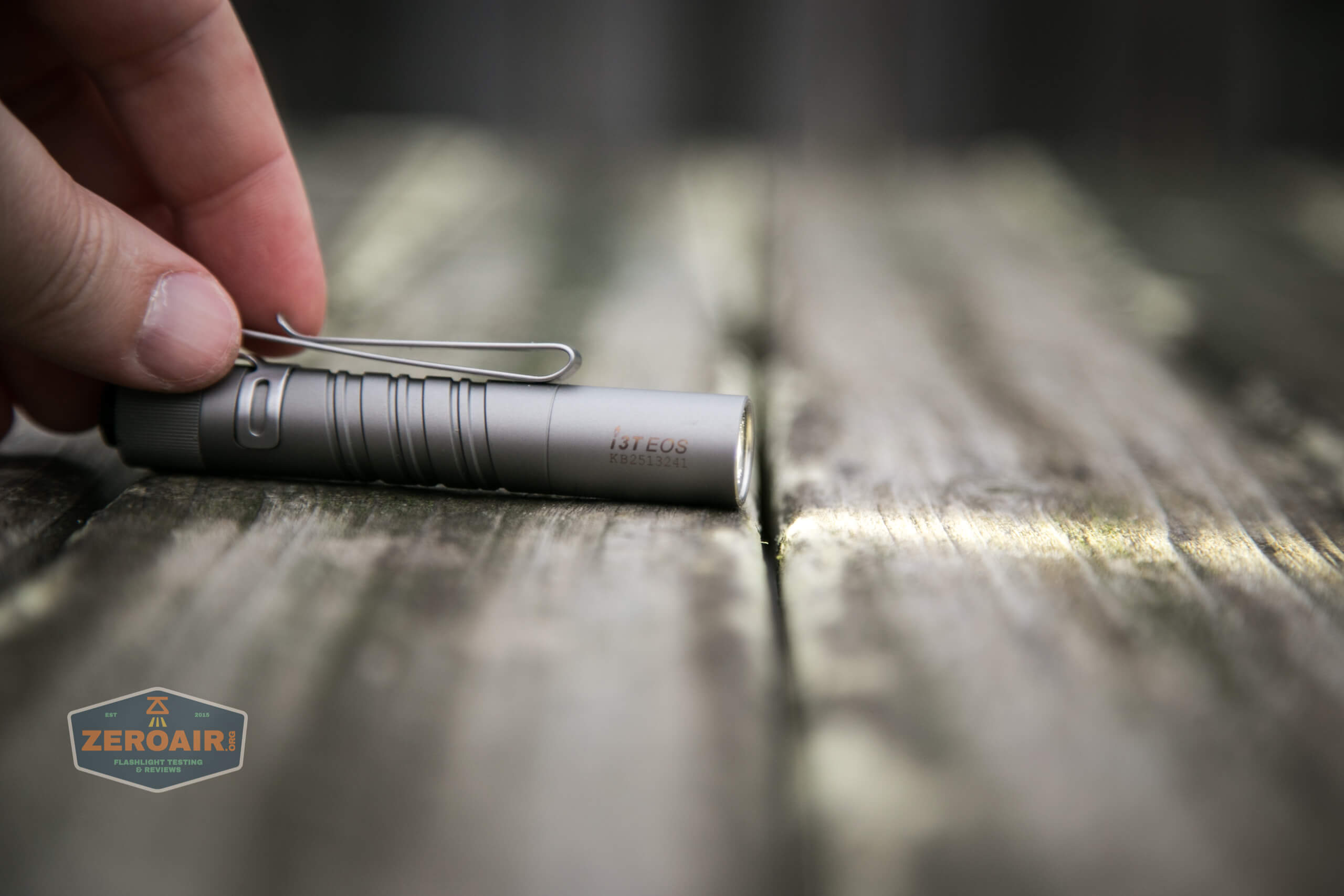 olight i3t eos titanium aaa flashlight on