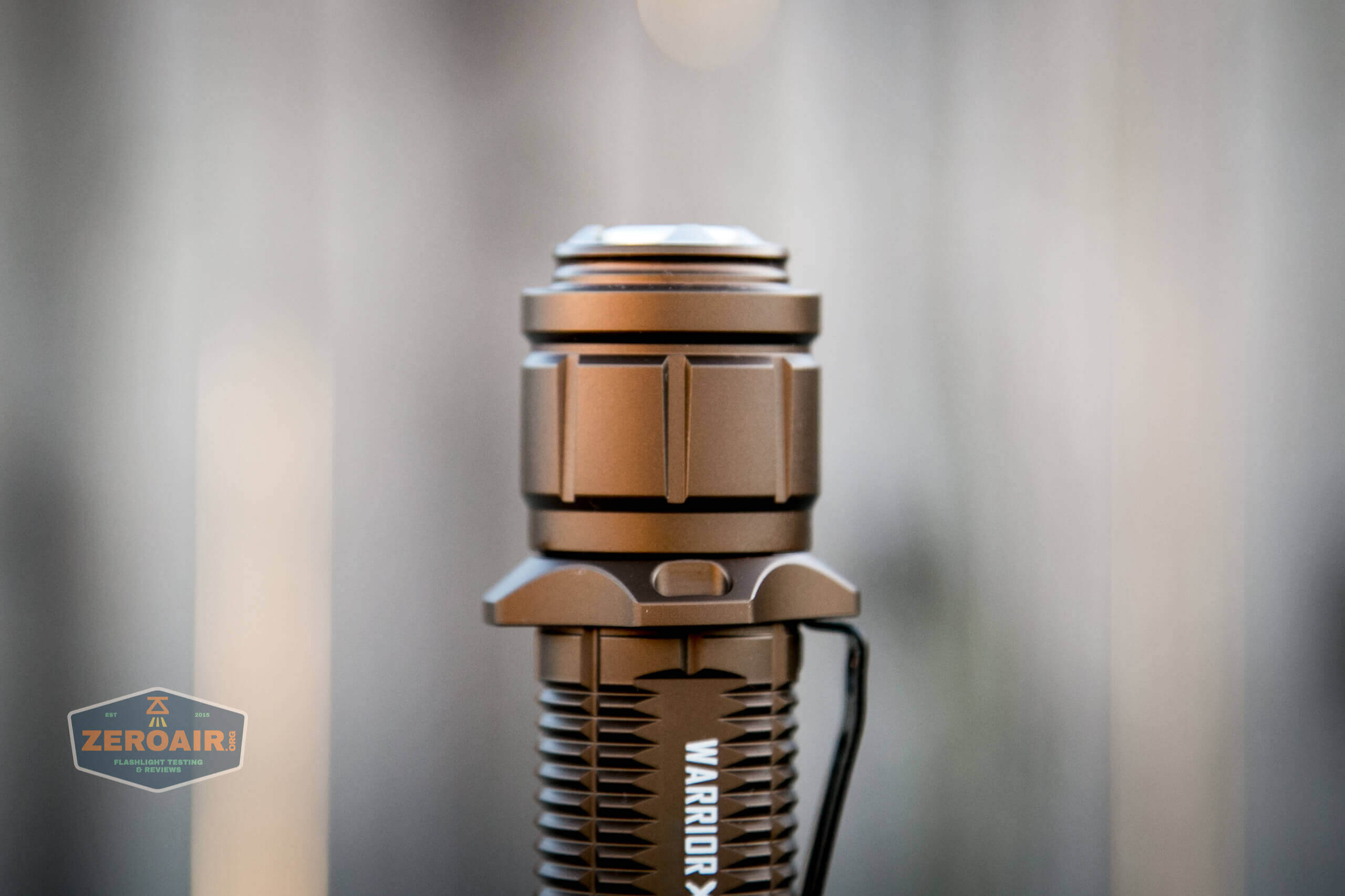 olight warrior x turbo desert tan flashlight tailcap profile
