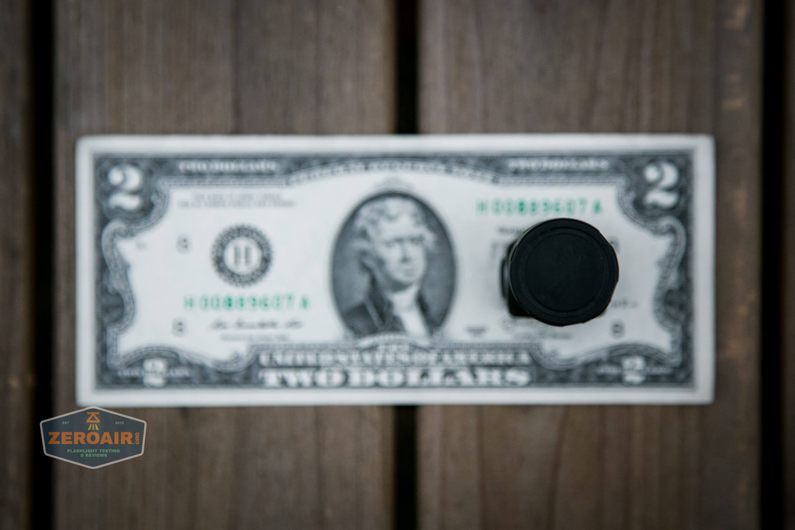 skilhunt h04 mini 18350 headlamp on two dollar bill