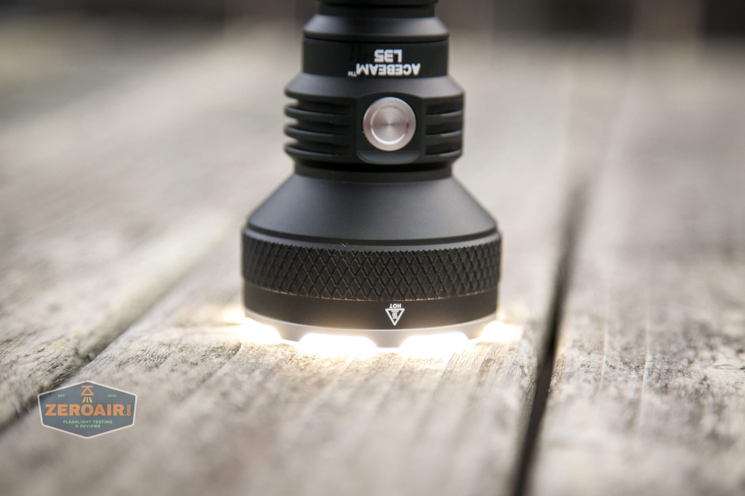 acebeam l35 flashlight headstanding and turned on