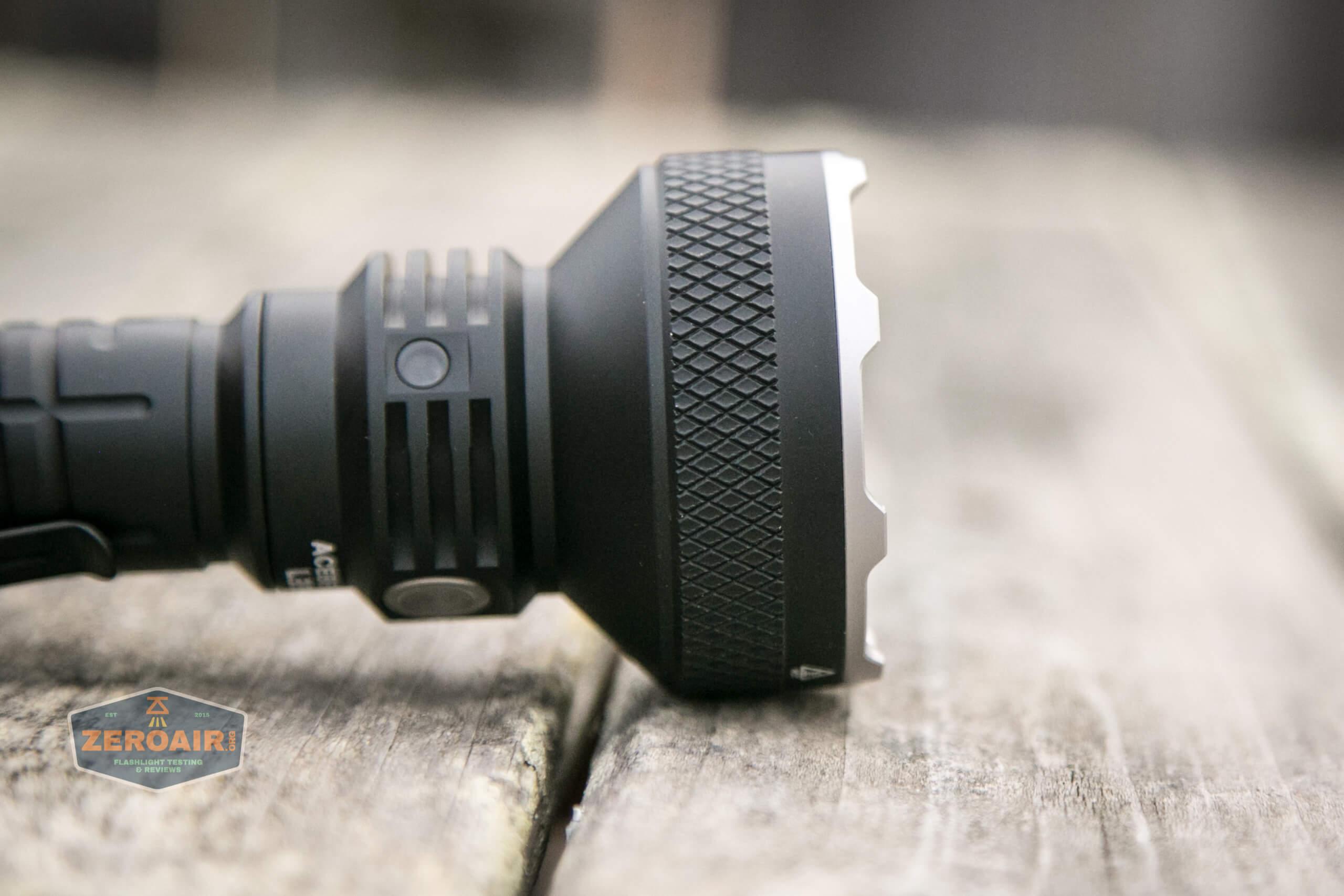 acebeam l35 flashlight laying on side, bezel detail