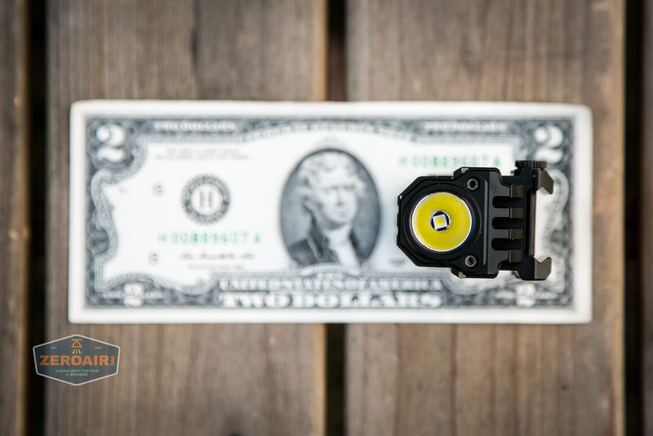 imalent ut10 tactical weapon flashlight on two dollar bill