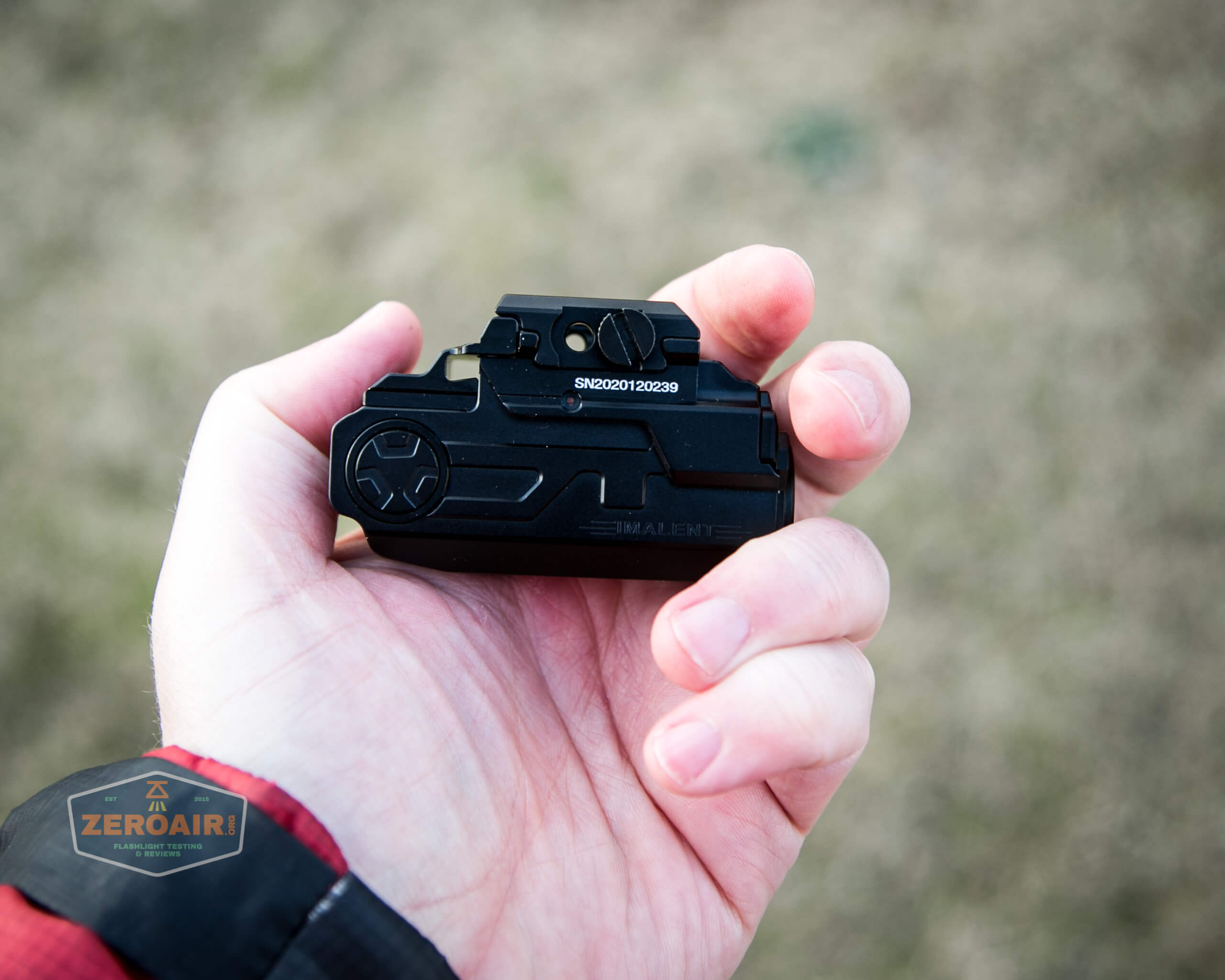 imalent ut10 tactical weapon flashlight in hand