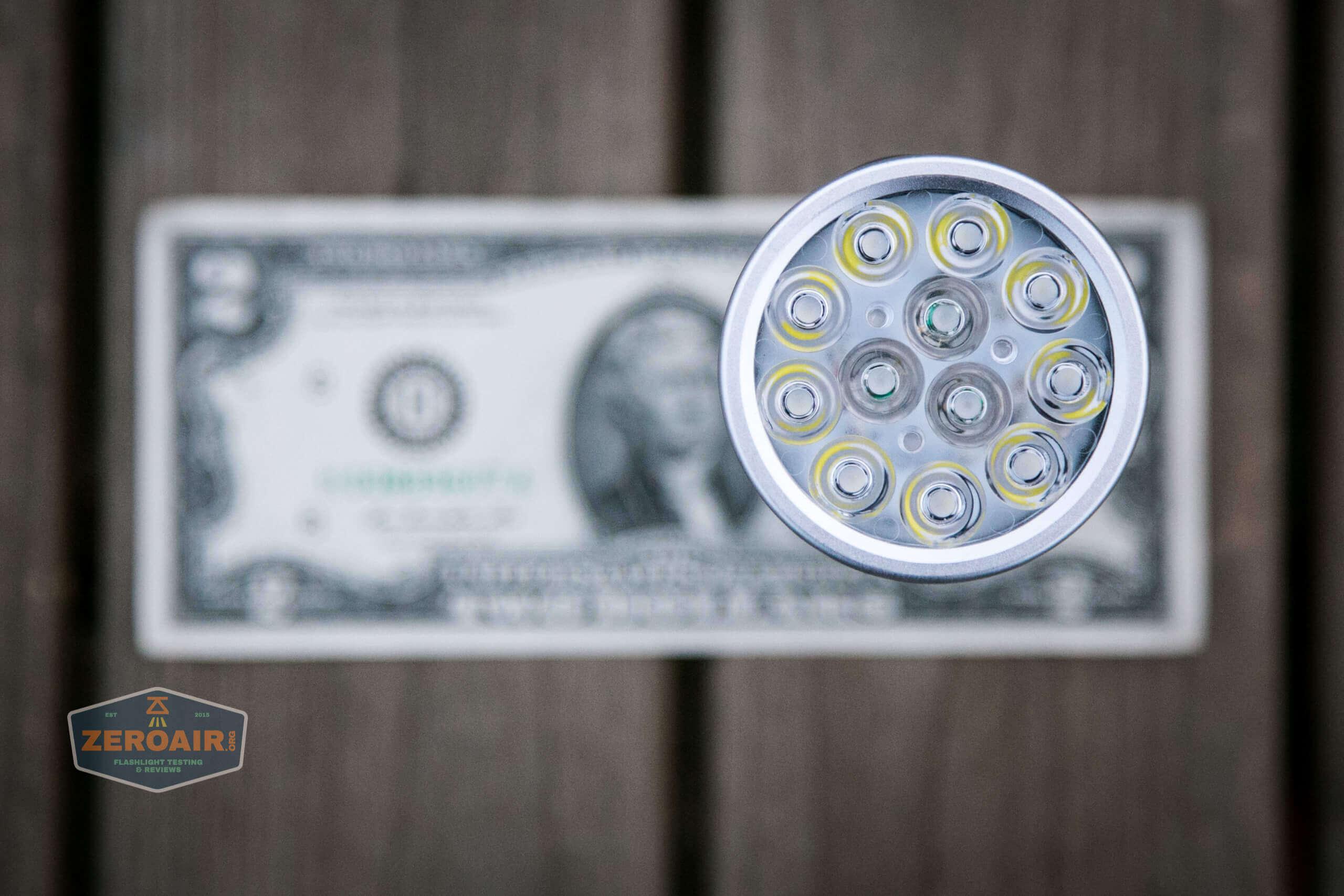nitebeam x12uv flashlight on two dollar bill
