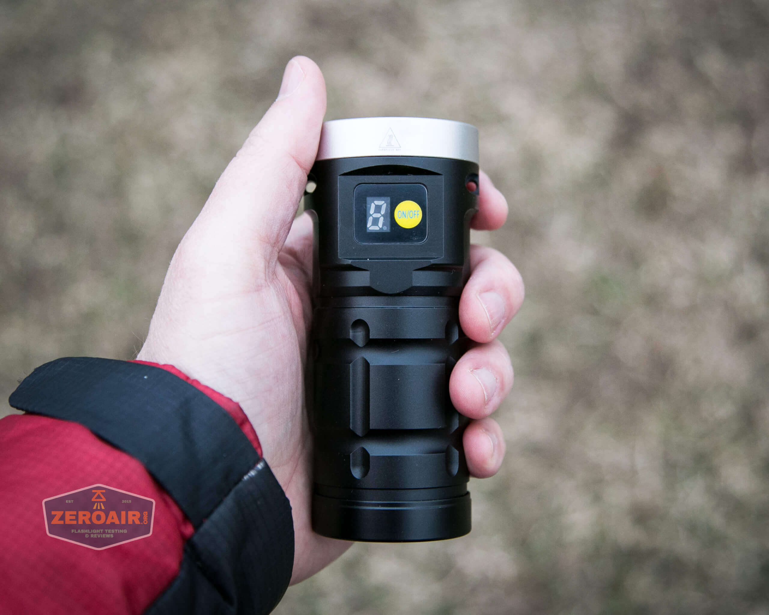 nitebeam x12uv flashlight in hand