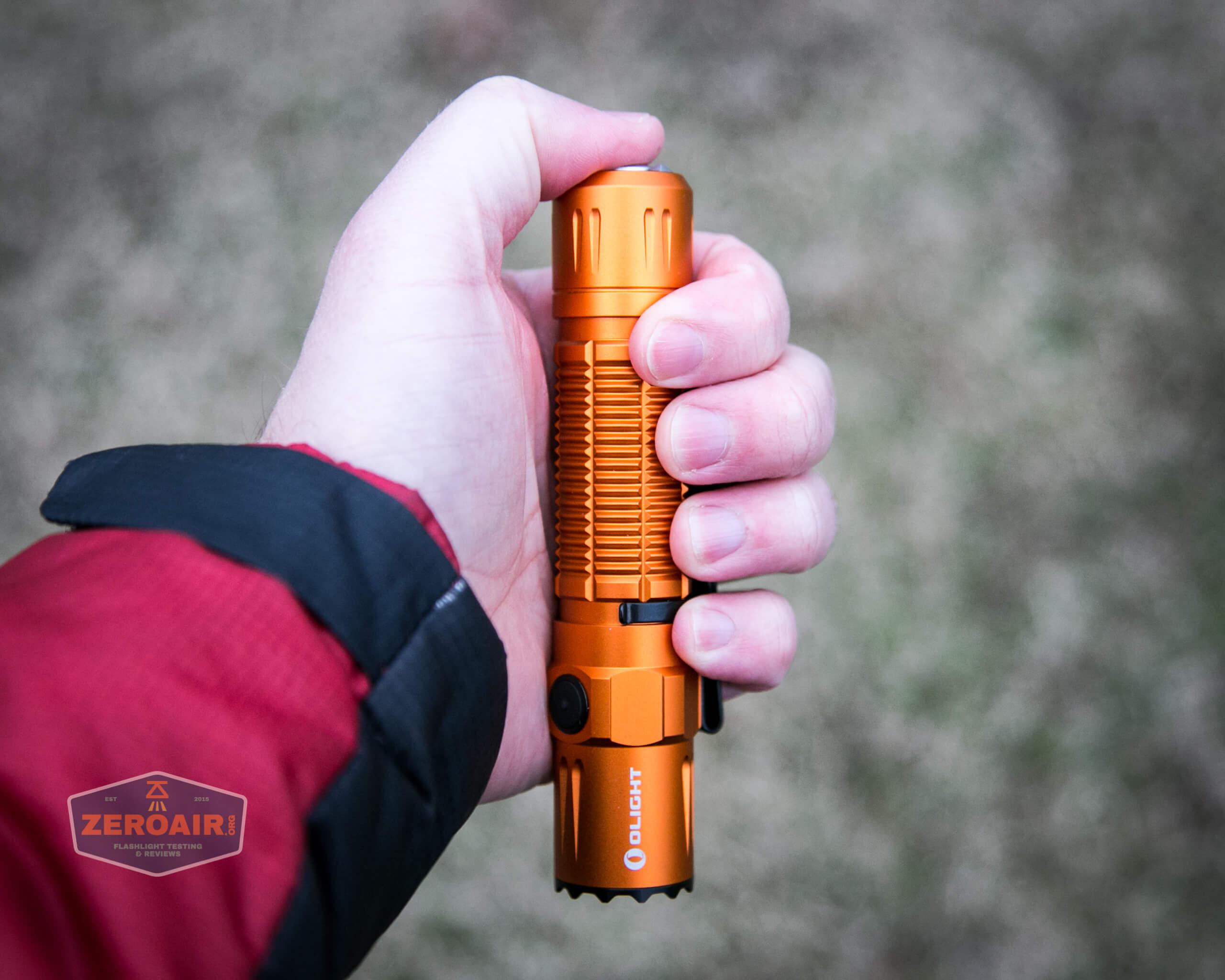 Olight M2R Pro Warrior Orange in hand