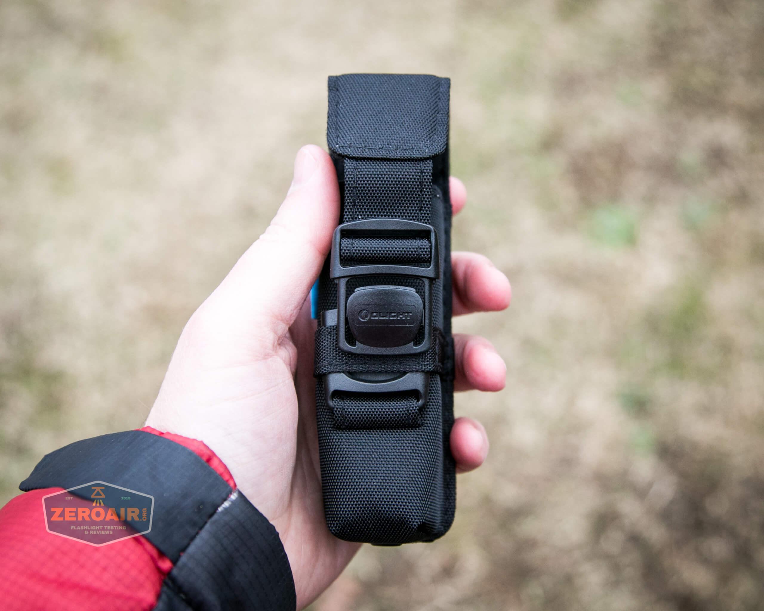 Olight M2R Pro Warrior Orange nylon pouch in hand