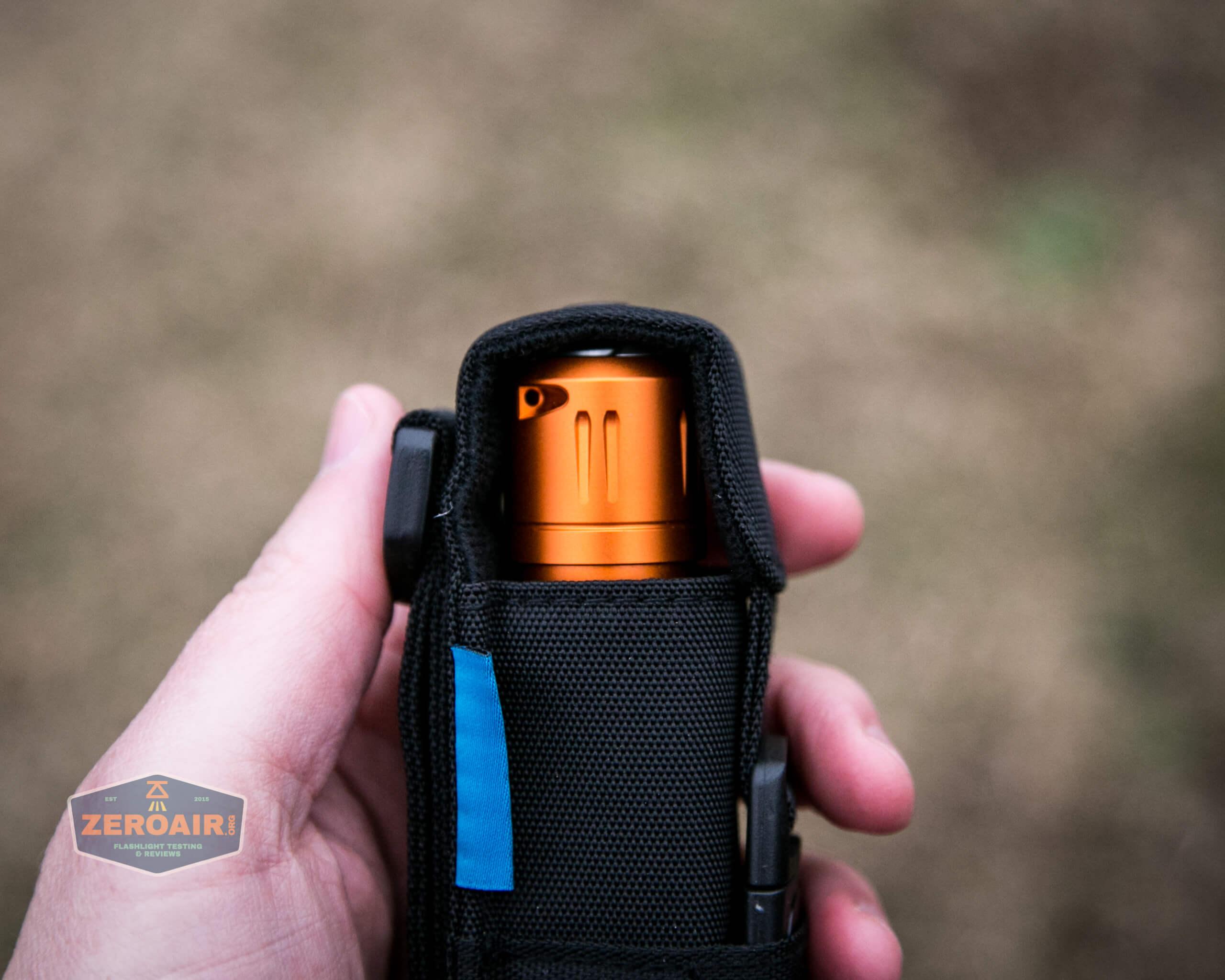 Olight M2R Pro Warrior Orange nylon pouch in hand bezel down