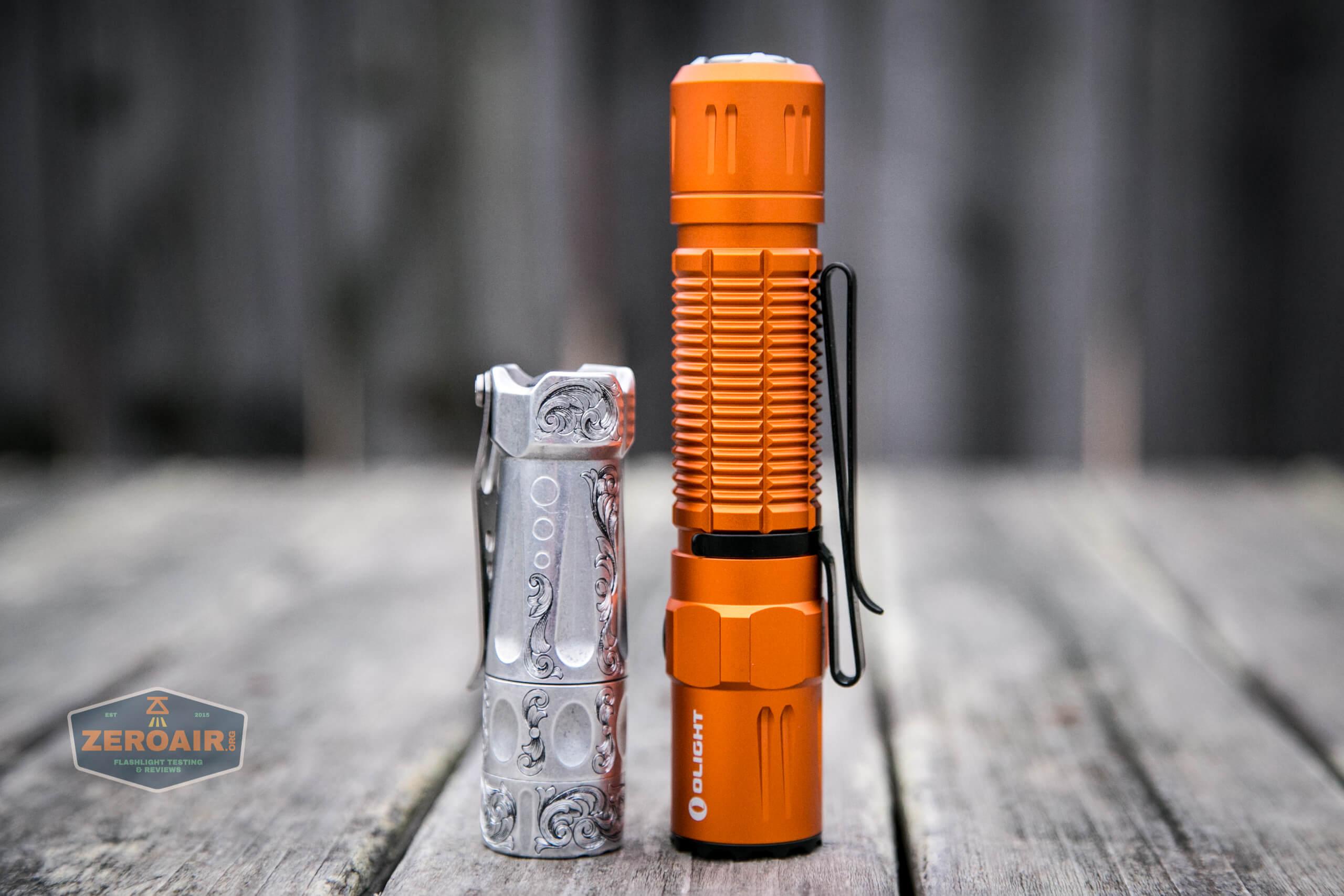 Olight M2R Pro Warrior Orange beside torchlab boss 35