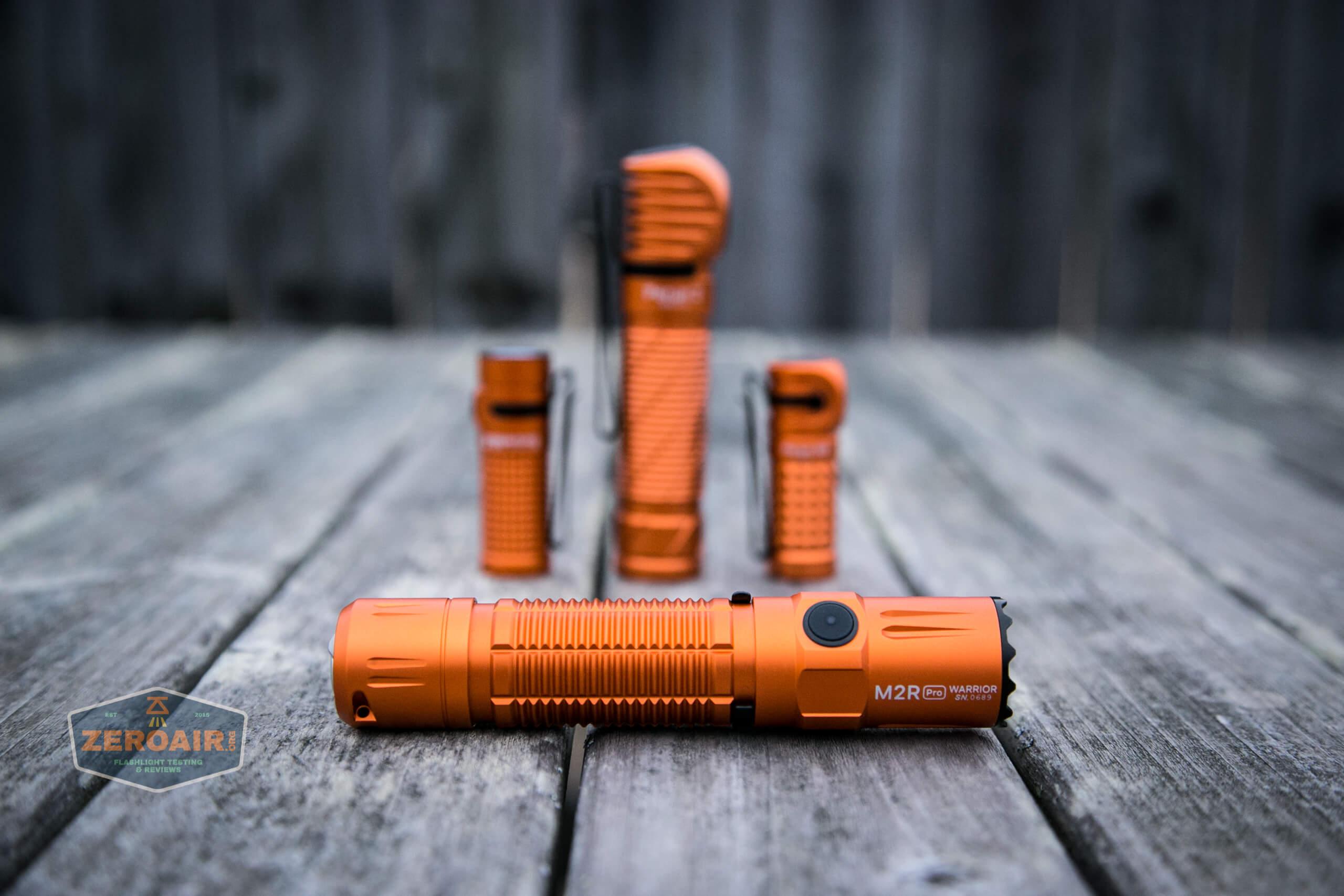 Olight M2R Pro Warrior Orange with other orange olights