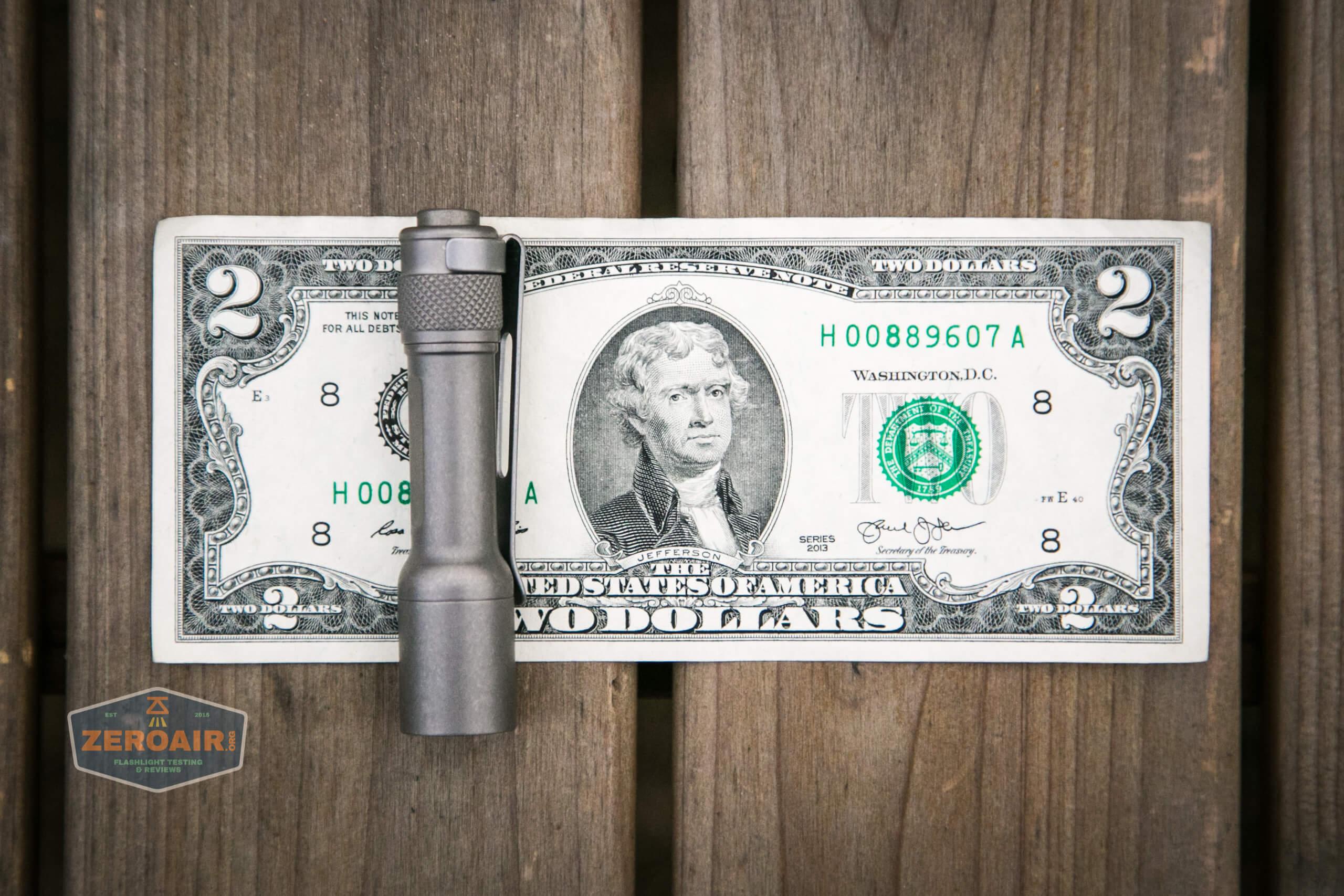 Seeknite SK03 on two dollar bill